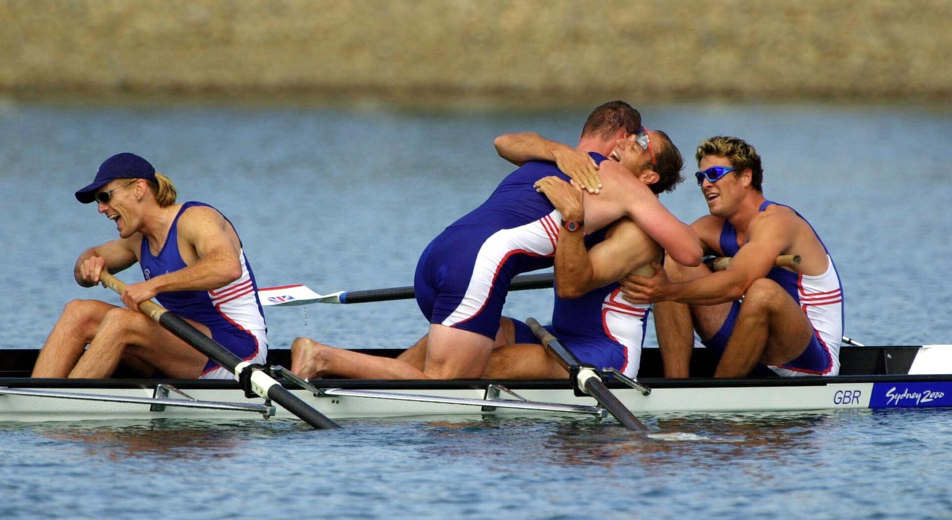 Great Britain rowers (left to right) Tim Foster, Matthew Pinsent, Steve Redgrave, and James Cracknell celebrate after winning the Gold Medal in the Men's Coxless Four Final at the Olympic Games in Sydney in 2000 (Toby Melville/PA)