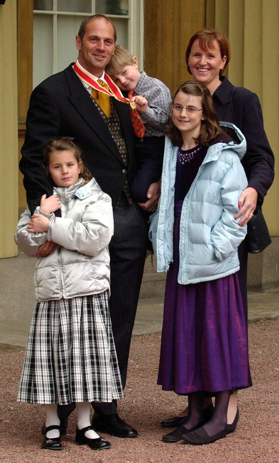 Sir Steven Redgrave with his wife, Lady Redgrave, son Zak, 3 and daughters Sophie, 7, left and Natalie, 9, at Buckingham Palace, London, Tuesday 1st May, 2001, after the 5 times Olympic gold medallist, received a Knight Batchelor from Britain's Queen Elizabeth II. in 2001 (Fiona Hanson/PA)