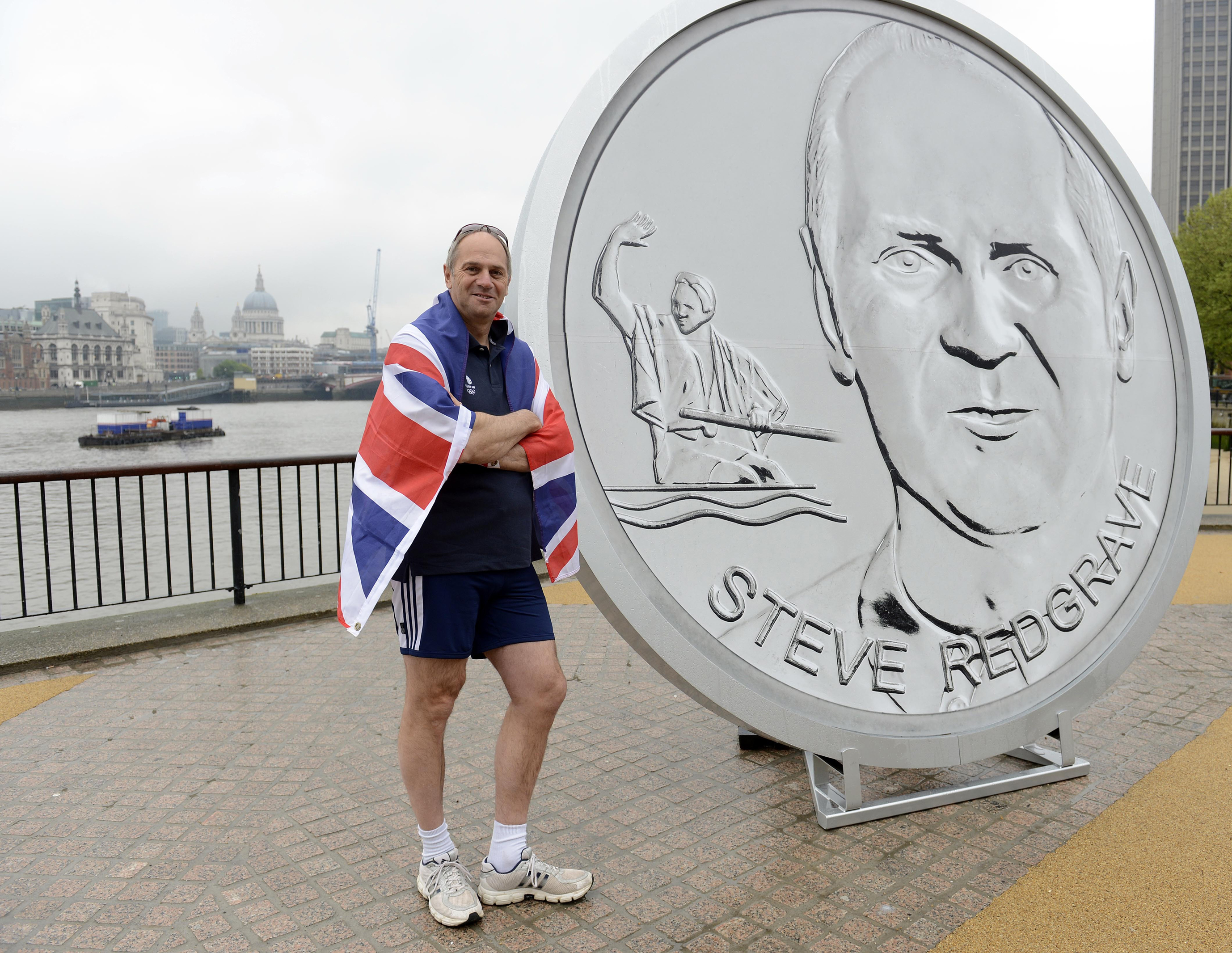 Sir Steve Redgrave stands in front of a giant medallion, featuring his face and a Olympic celebratory pose, on the Southbank, London, during the launch of Our Greatest Team Legends Collection in 2012 (Rebecca Naden/PA)