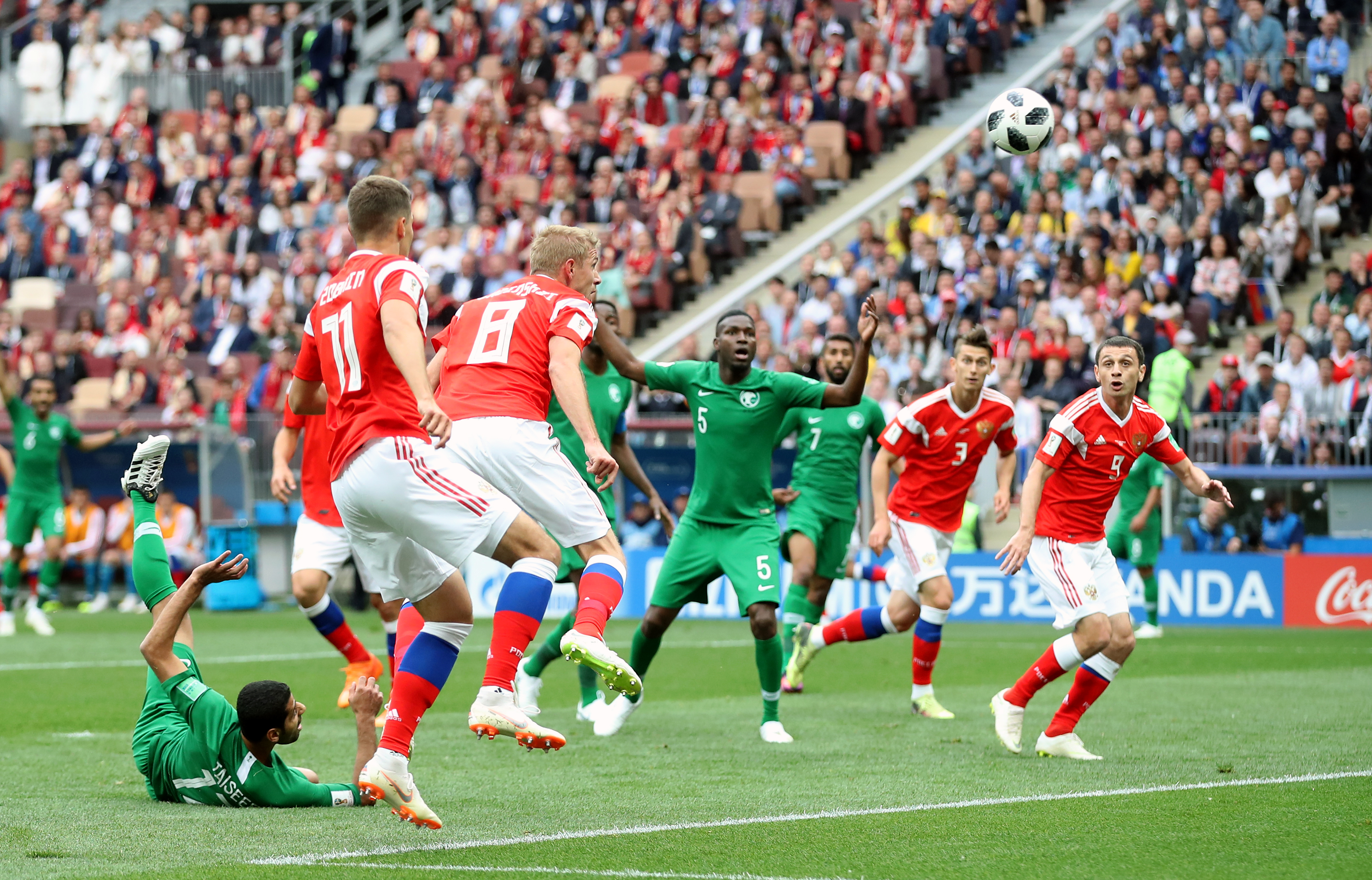 Russia's Yury Gazinsky (no.8) scores his side's first goal of the game (Adam Davy/PA)