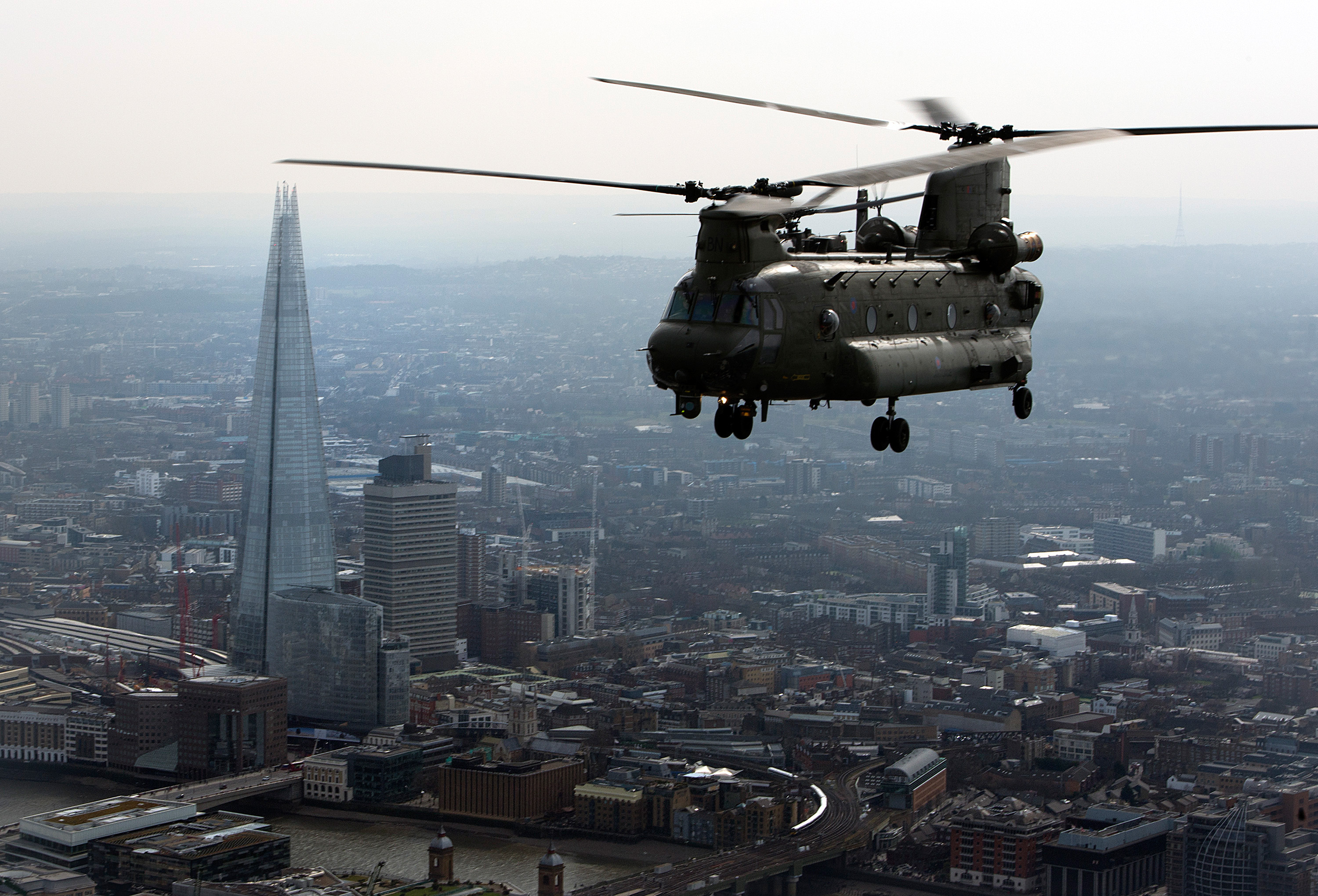 An RAF Chinook flies over central London