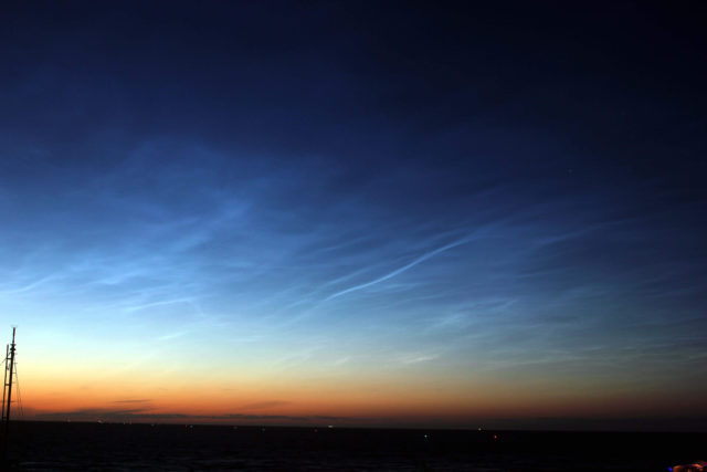 Noctilucent clouds at night sky.