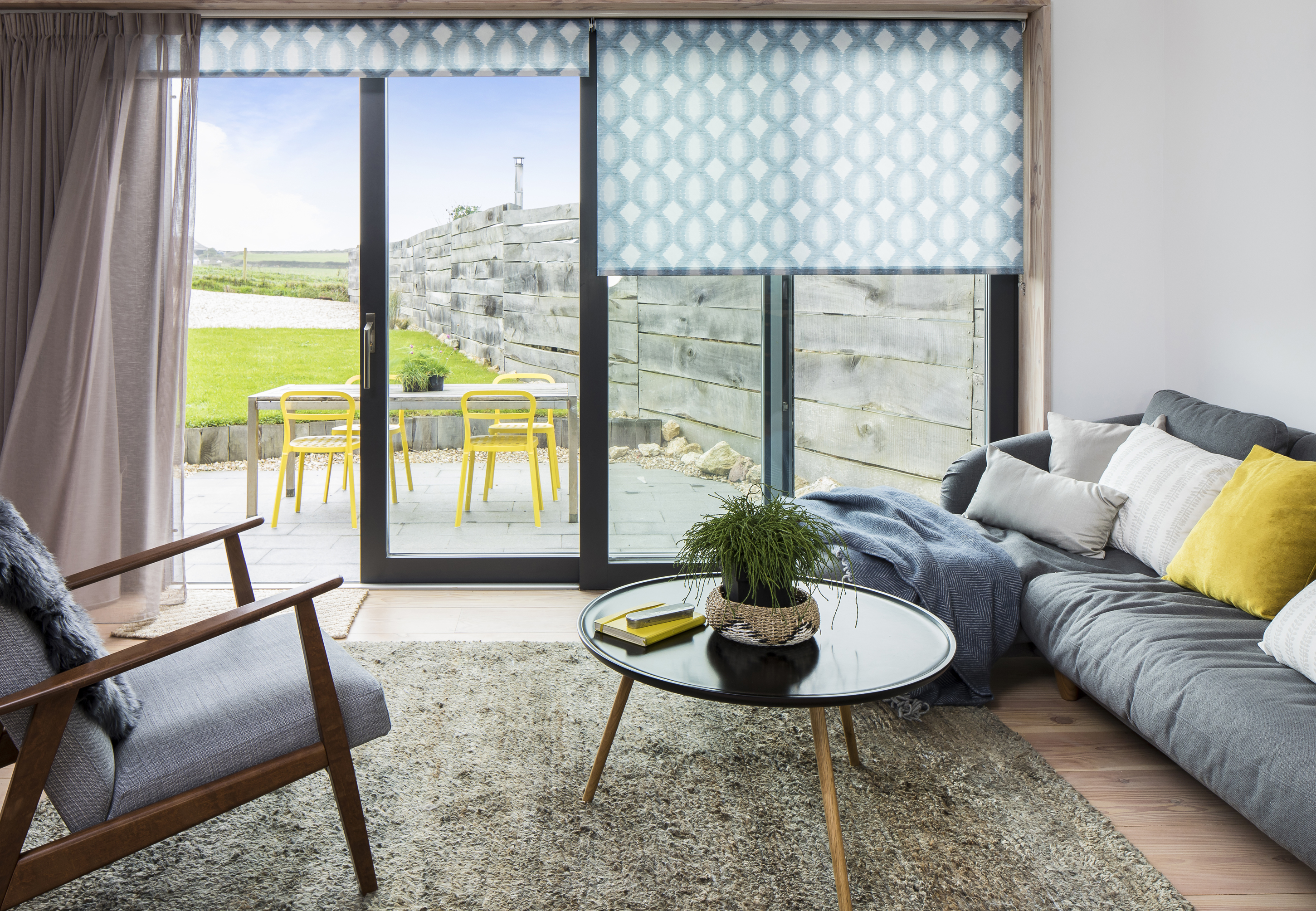 have an endless summer with these 35 beach house decor ideas home decor The lounge at Charlie Luxtonu0027s coastal home with Brindle Denim Drift Roller  Blind, from £72 and Serene Linen Voile, from £54 a pair, both from Hillarys  ...