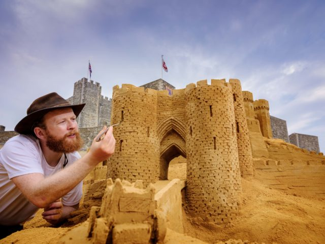 Sand sculptor Jamie Wardley describes making the castle as a 'once in a lifetime experience' (English Heritage/PA)