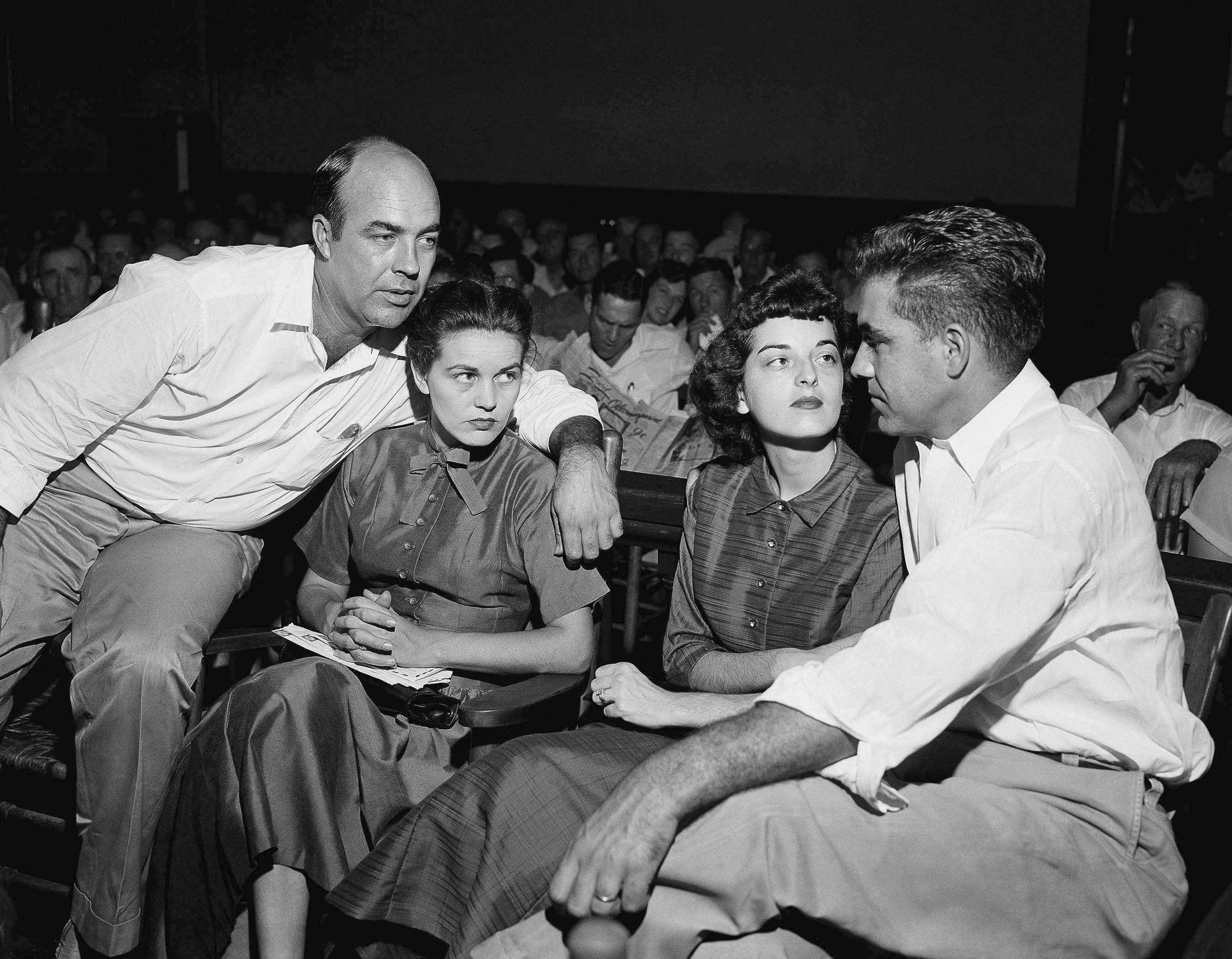 JW Milam, left, his wife, Roy Bryant, far right, and his wife Carolyn Bryant in a courtroom in Sumner, Mississippi