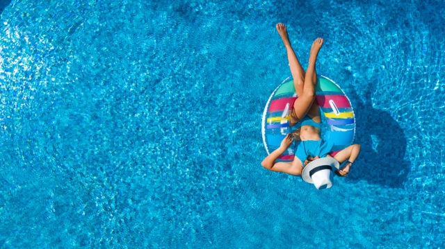 Aerial view of girl in swimming pool