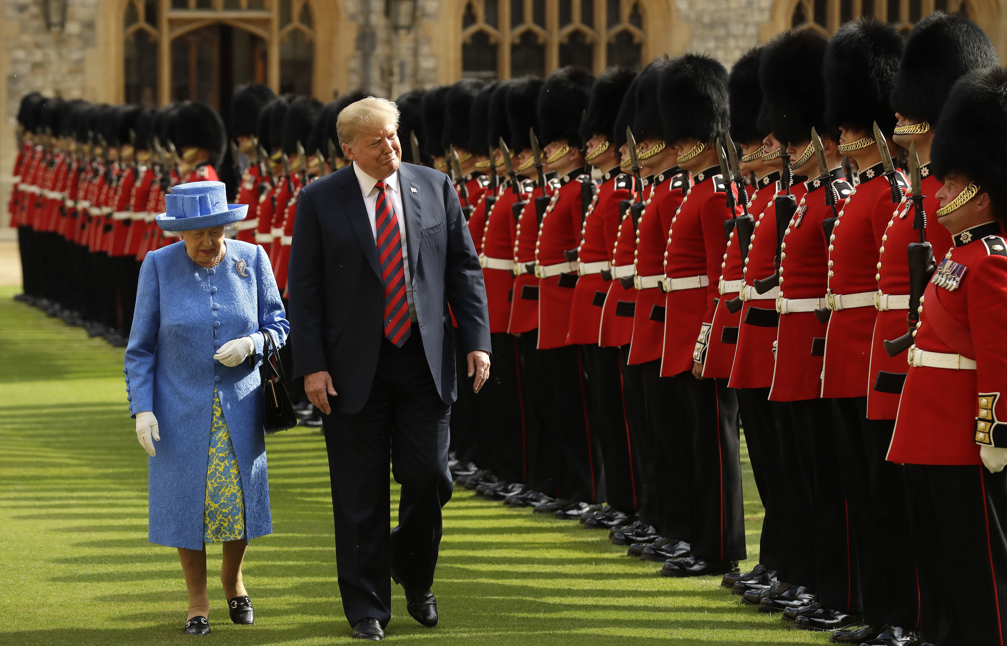 Donald Trump and the Queen inspect a guard of honour at Windsor Castle