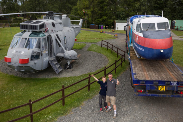 Martyn Steedman and son Harry with the Twin Pioneer and the Sea King already converted into accommodation (Craig Stephen/PA)