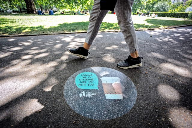 The campaign uses signs to remind people that carefully leaving their rubbish behind is still littering (Keep Britain Tidy/PA)