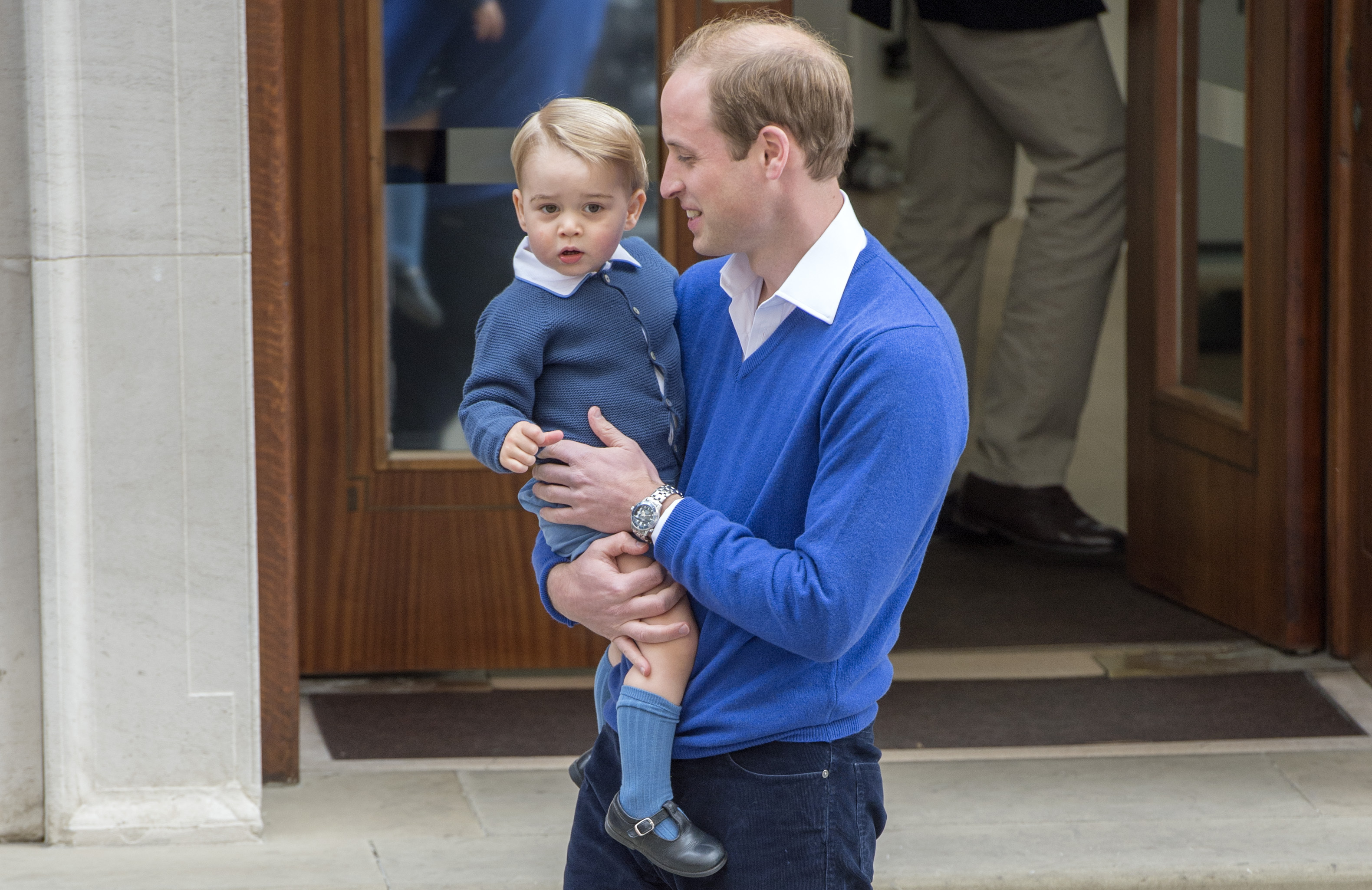 The Duke of Cambridge with his son Prince George as he arrives at the Lindo Wing of St Mary's Hospital in London, after the birth of his newborn daughter