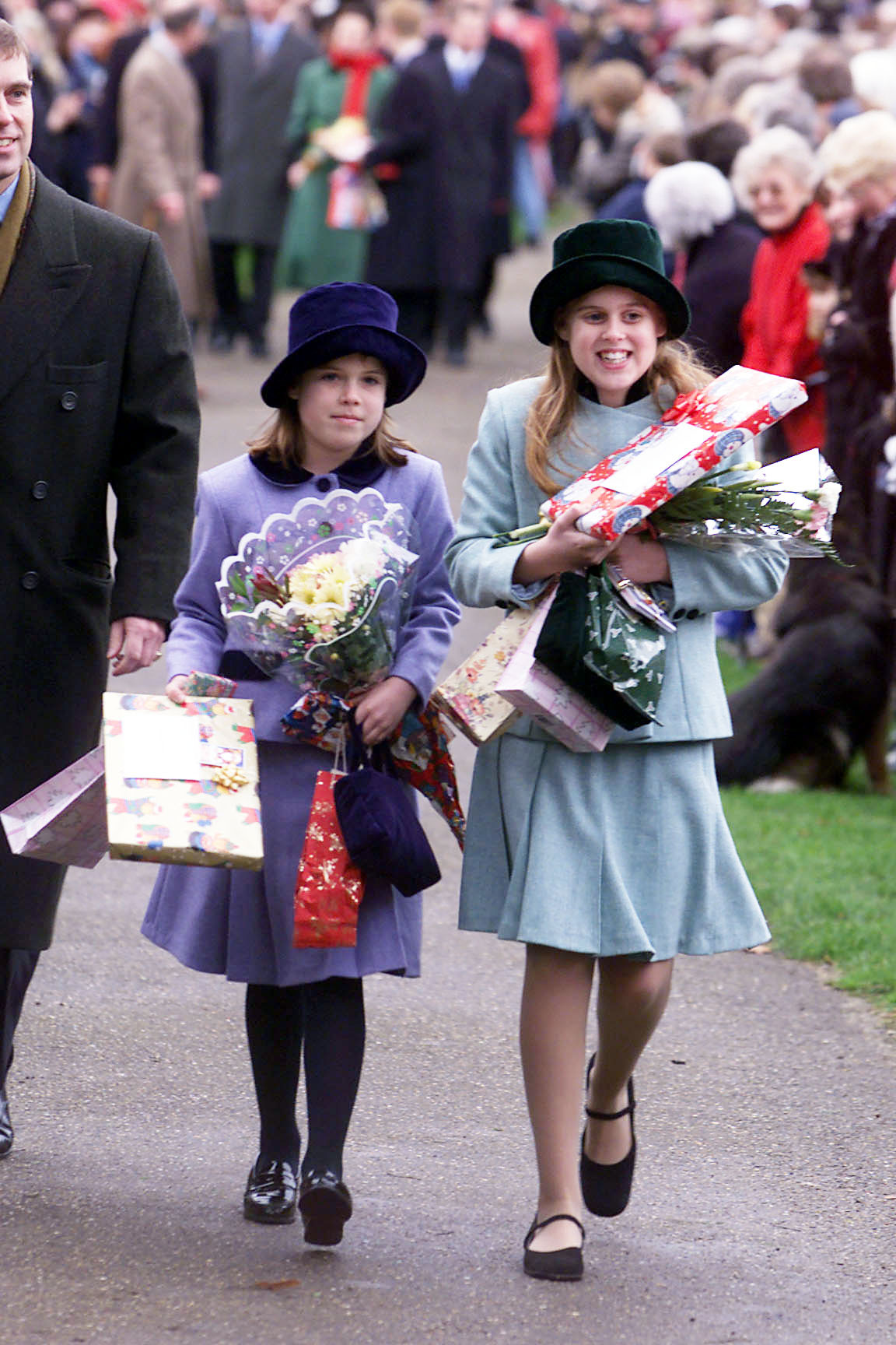 Prince Andrew's daughters Princesses Beatrice (right) and Eugenie arrive at Sandringham parish church Saturday 25 December 1999 for their traditional Christmas Day servic