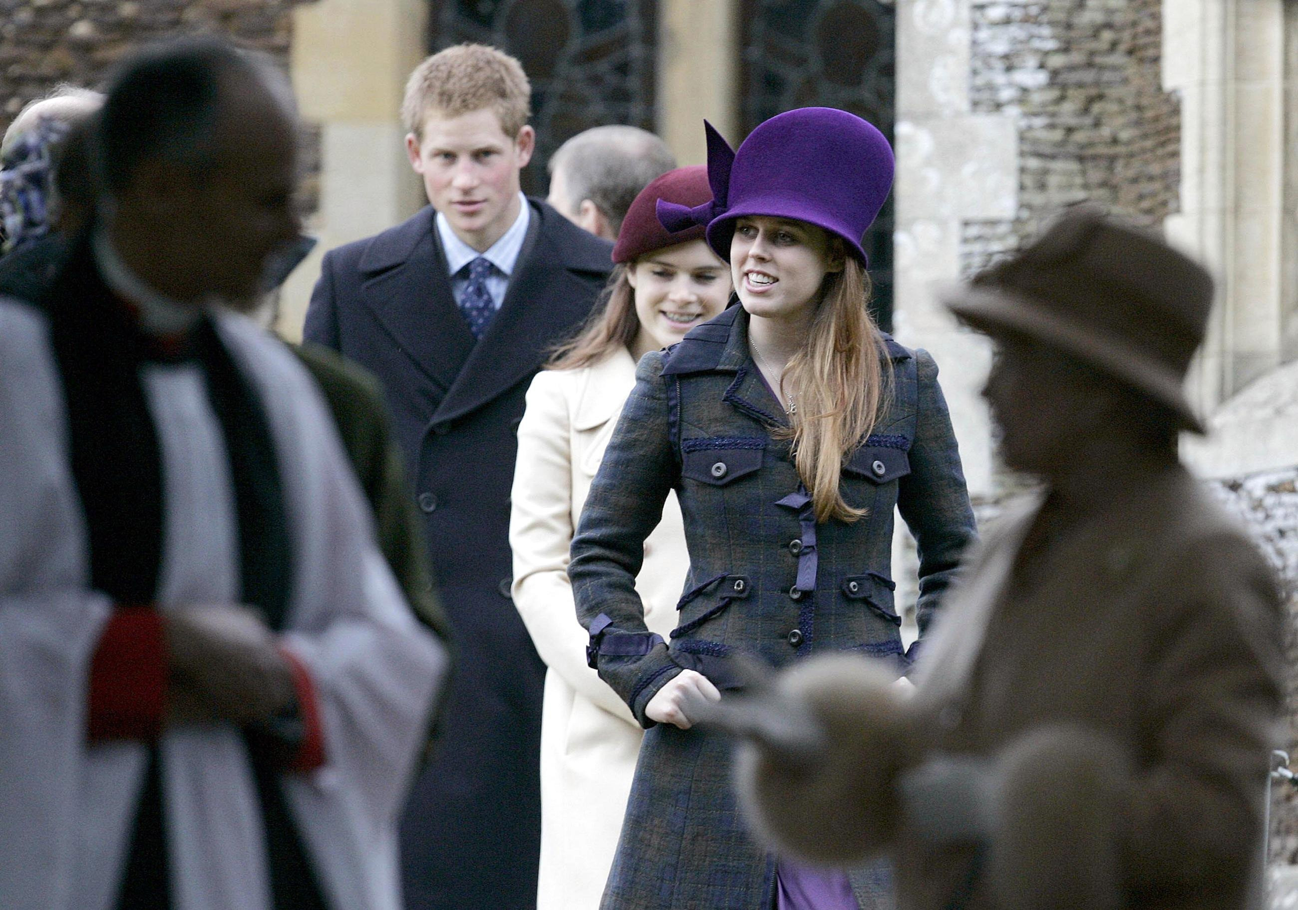 Princess Beatrice (front) Princess Eugenie and Prince Harry leave St Mary Magdalene Church, Sandringham, after attending the Christmas Day church service in 2005