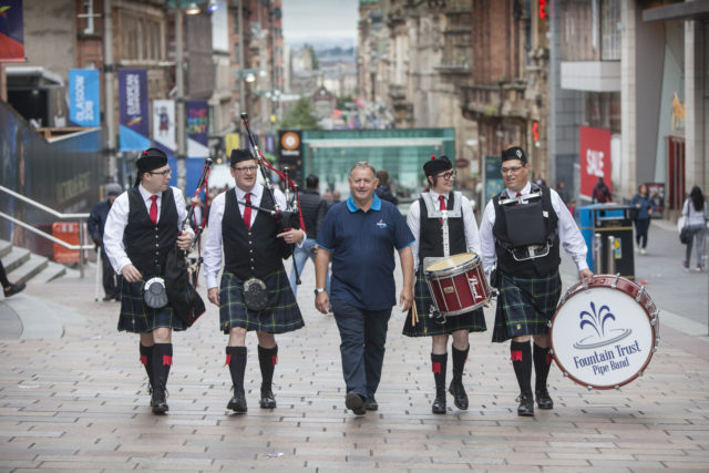 More than 8,000 pipers and drummers will take part in events across Glasgow (Chris James/PA)