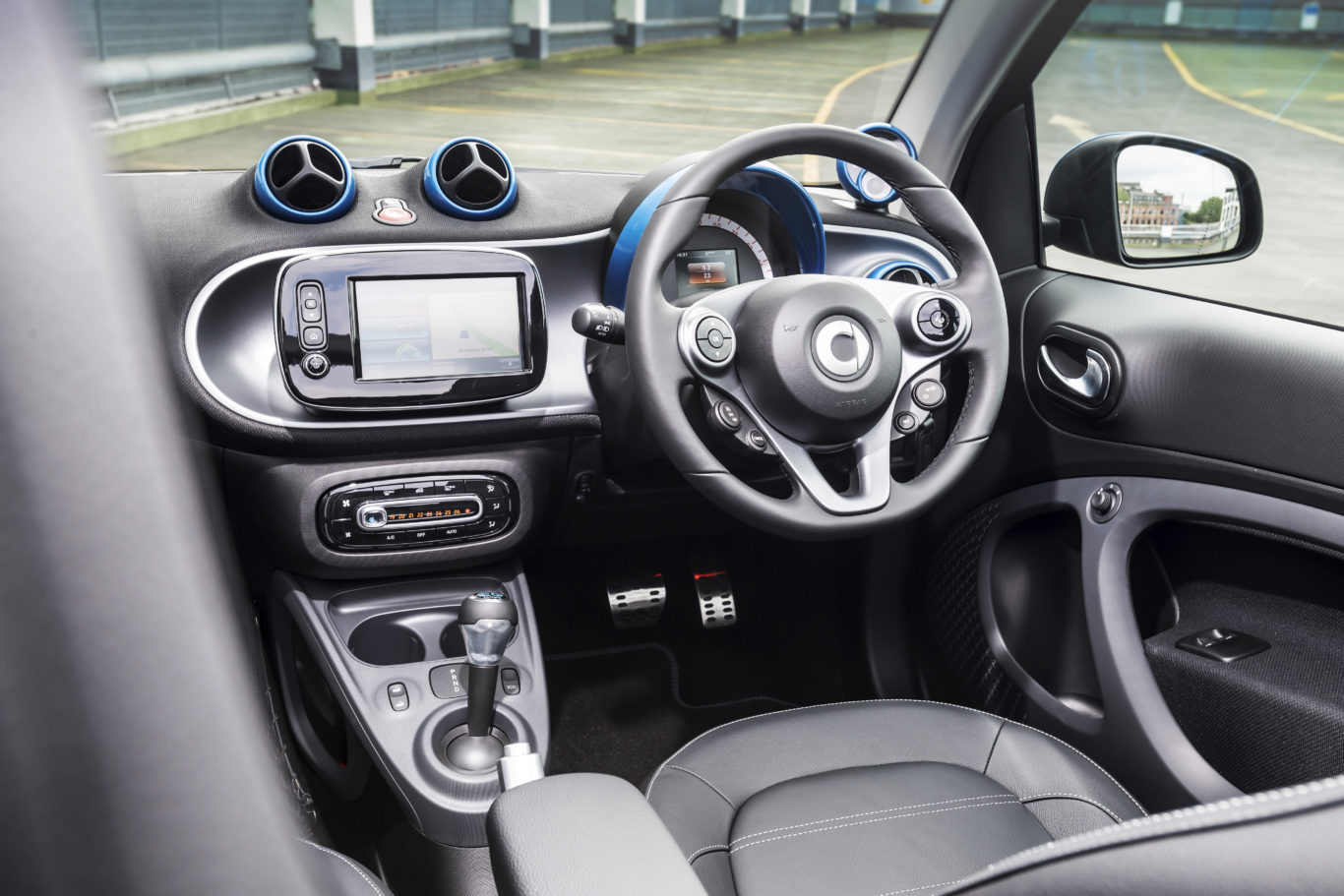 The cabin of the compact Smart is surprisingly spacious