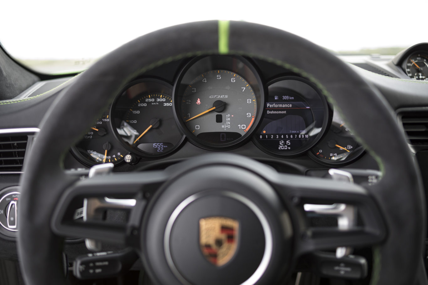 The Porsche's cabin is exceptionally driver-focused