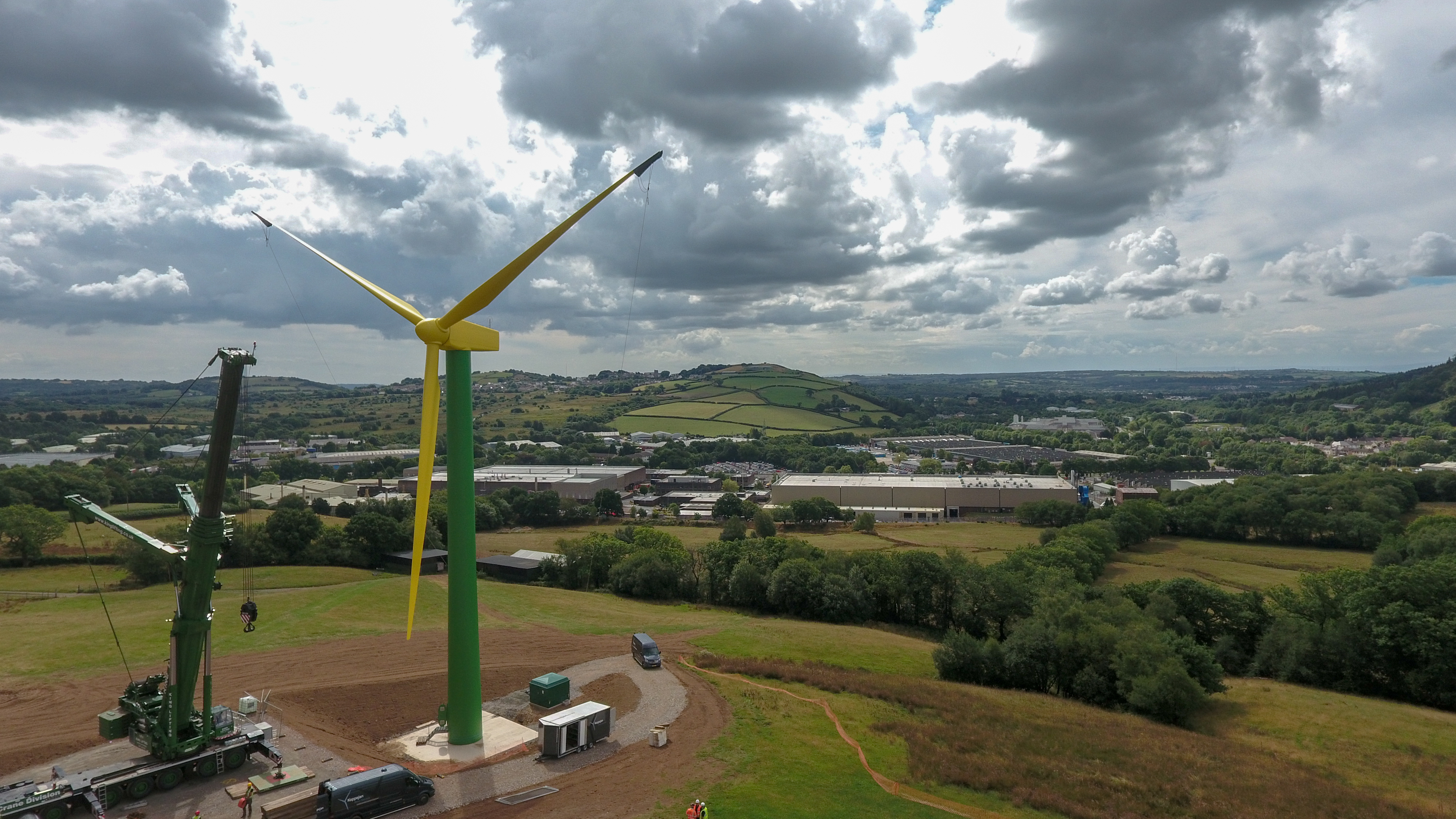 "The ""daffodil"" wind turbine on hills behind the Royal Mint in Llantrisant"