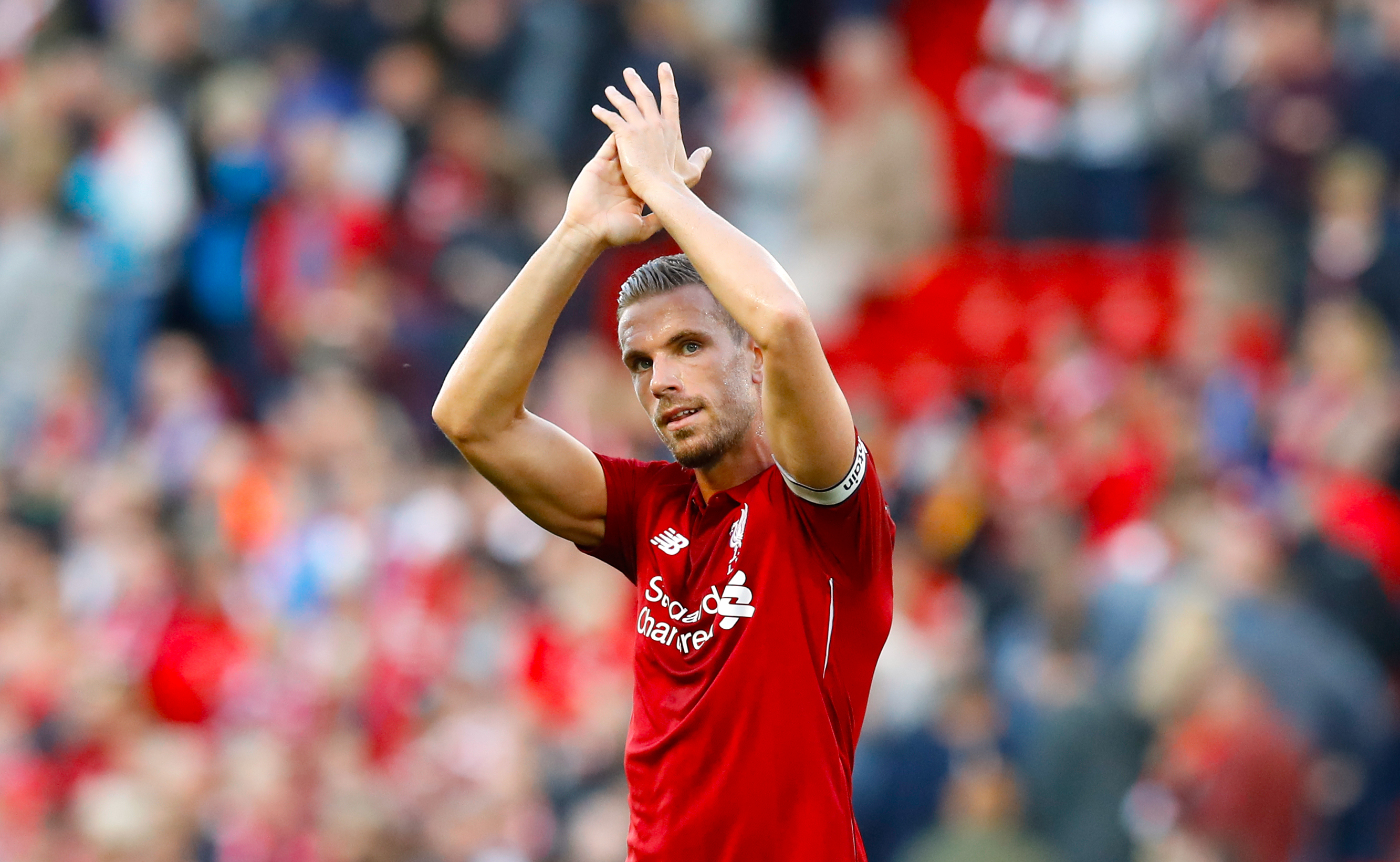 Liverpool's Jordan Henderson applauds the fans after the final whistle