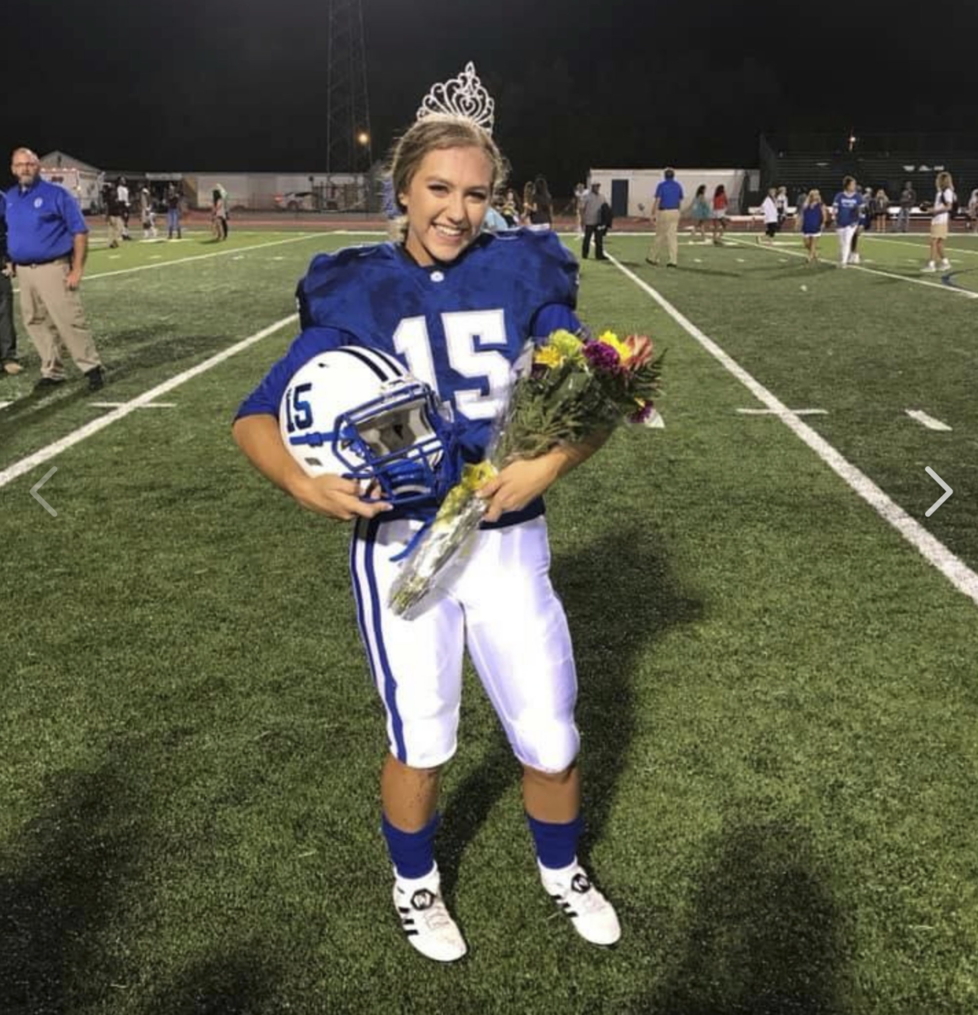 Ocean Springs High School's 2018 Homecoming Queen Kaylee Foster holds her football helmet