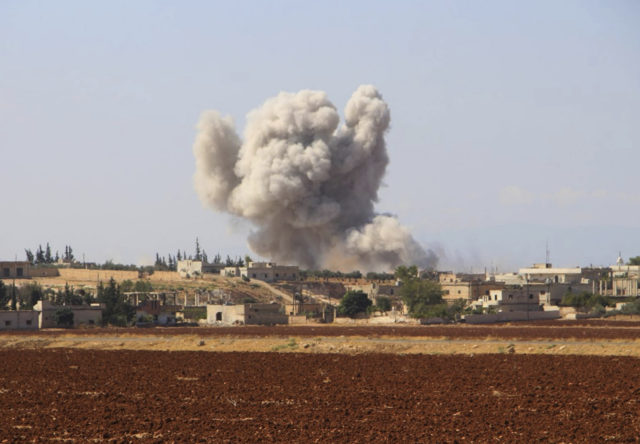 Smoke rising from a Syrian government air strike in Hobeit village