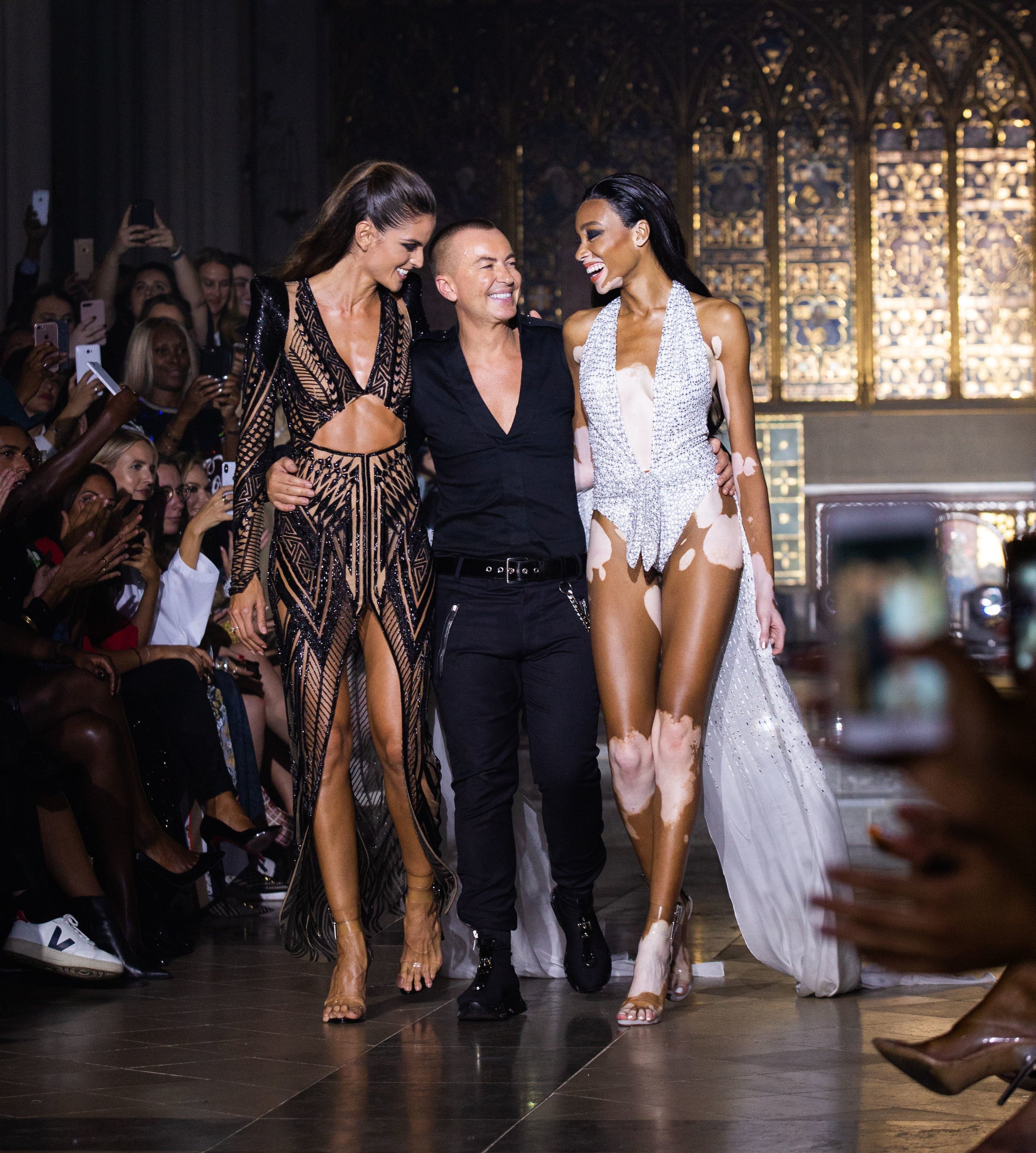 Model Winnie Harlow (right) with Julien Macdonald on the catwalk during his London Fashion Week show held at St John & Otilde's Hyde Park, London.