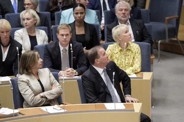 Stefan Lofven, right, during the vote of confidence