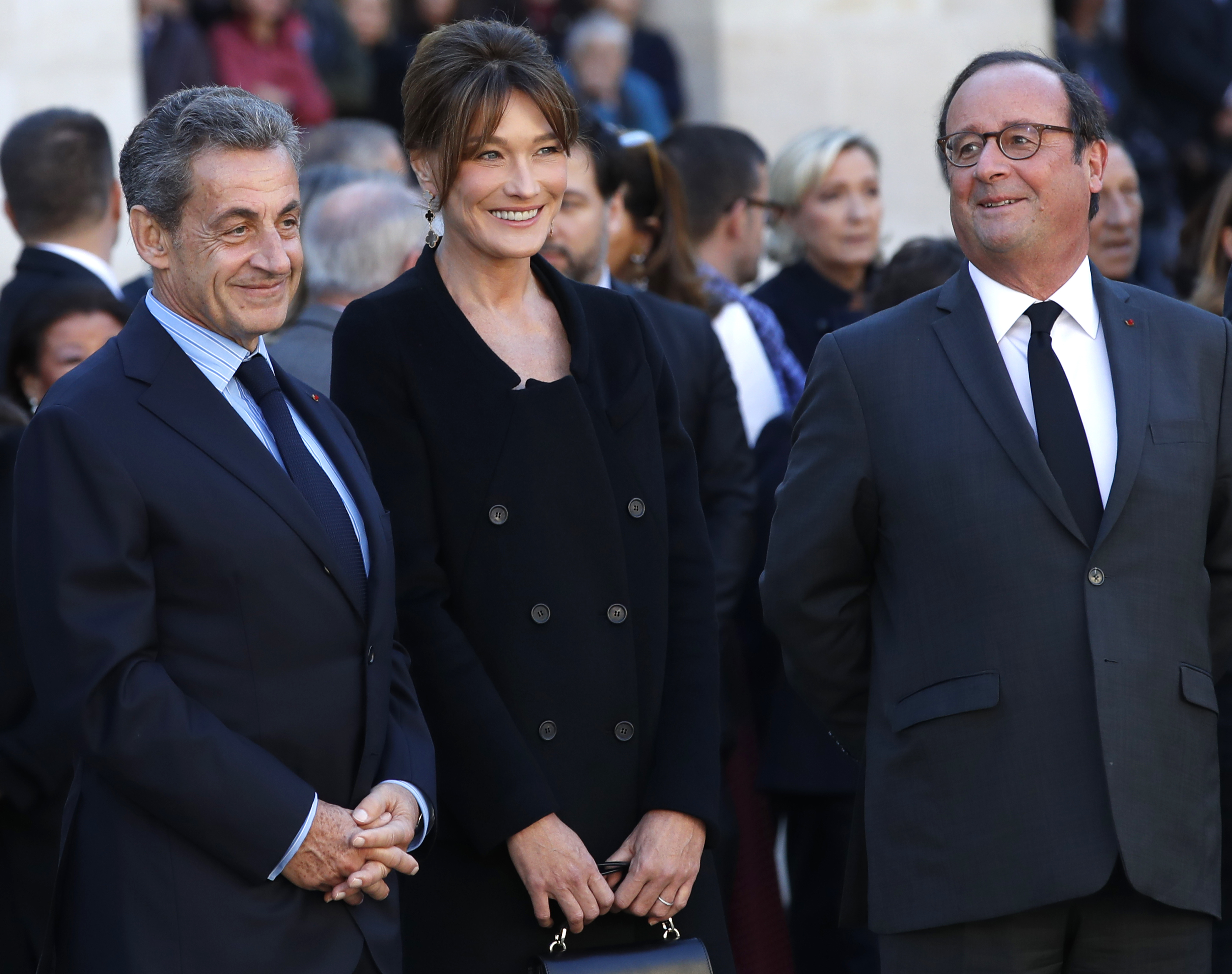 Nicolas Sarkozy, left, his wife Carla Bruni Sarkozy and Francois Hollande