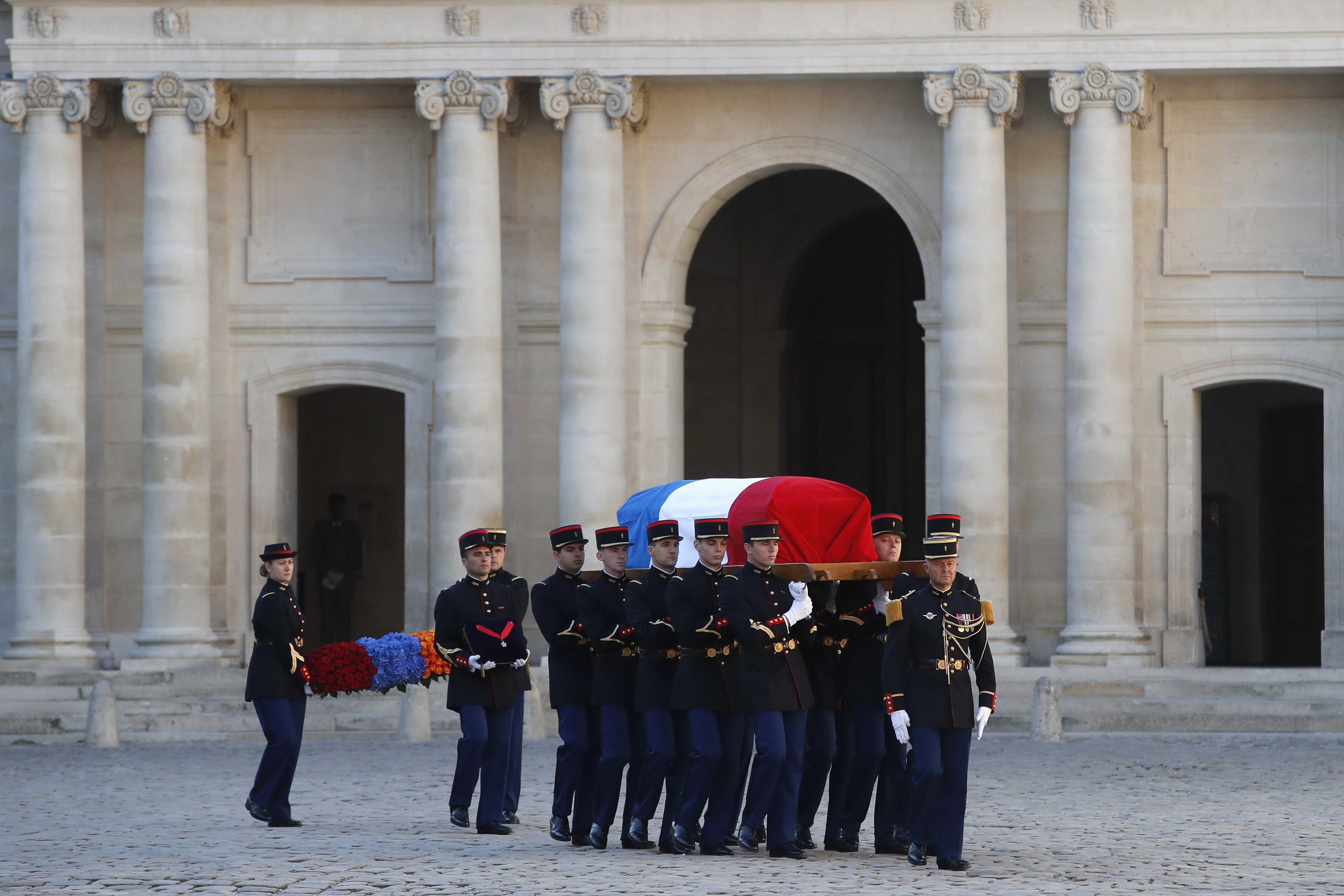 Soldiers carry the coffin of Charles Aznavour during a ceremony in Paris