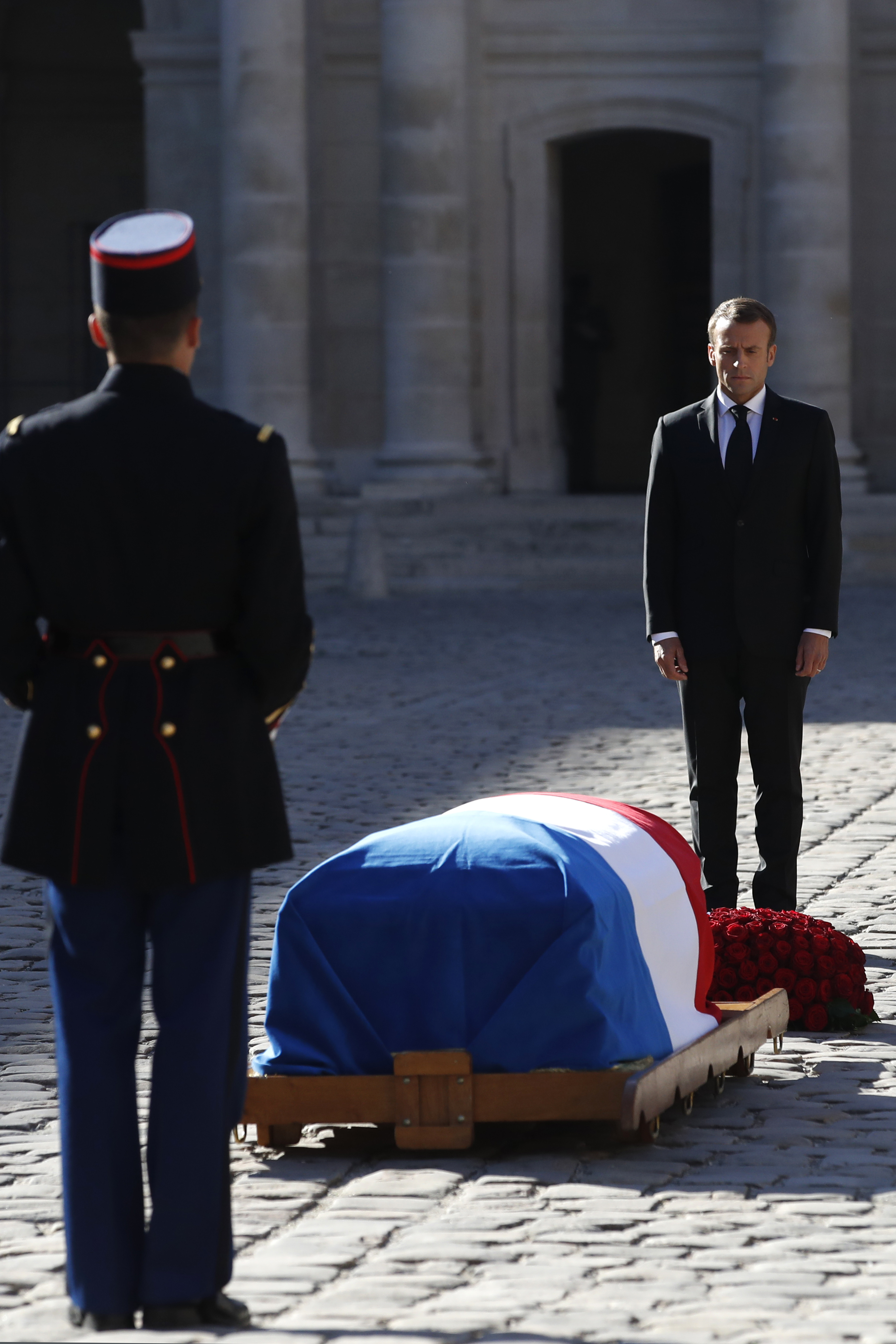 Emmanuel Macron stands in front of the coffin of Charles Aznavour