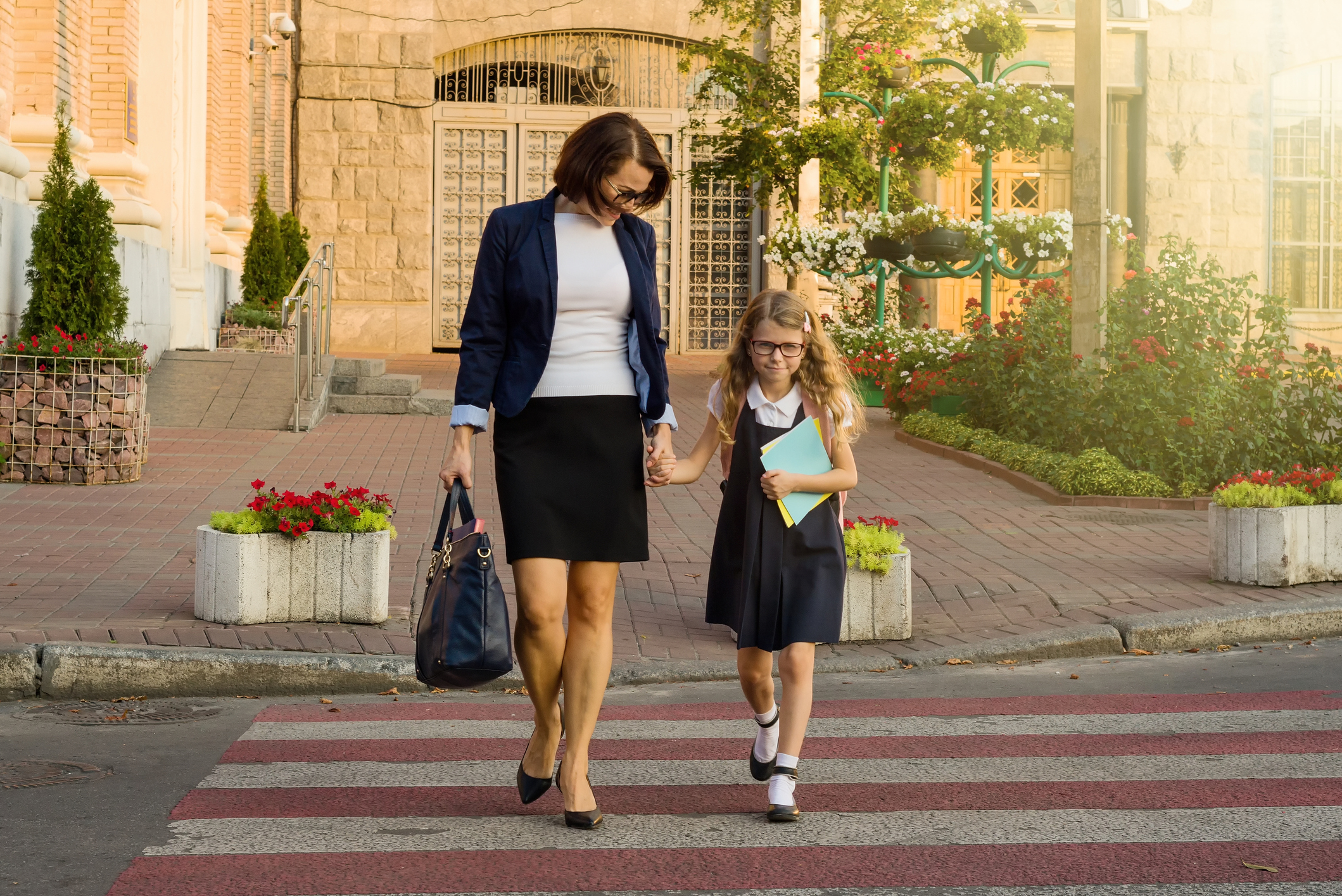 mum picking up her daughter from school and walking home