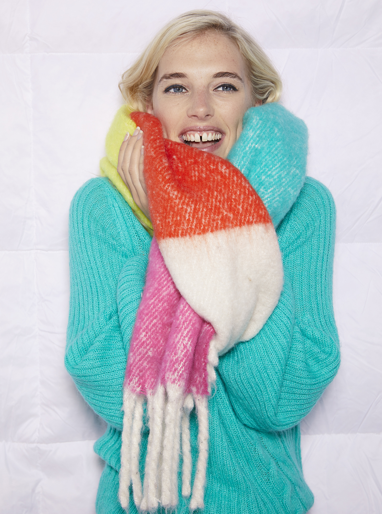 model wearing Oliver Bonas Optimistic Stripe Scarf and Works Green Cable Knit Jumper