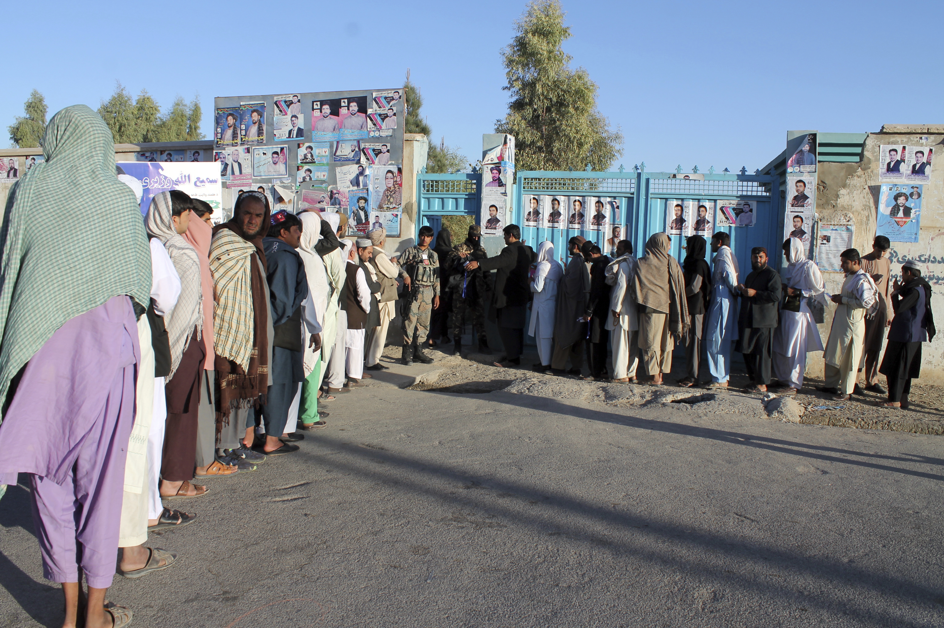 Afghan men line up to cast their votes in Helmand province