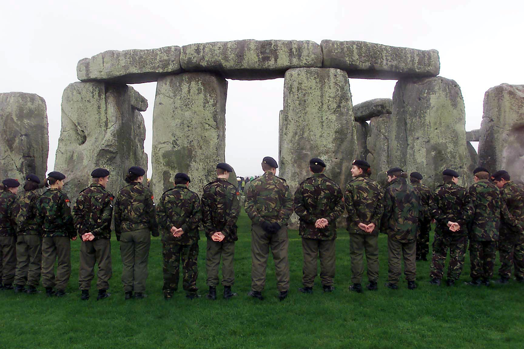 Army cadets and members of the Royal British Legion forming a circle of remembrance at Stonehenge in 2000