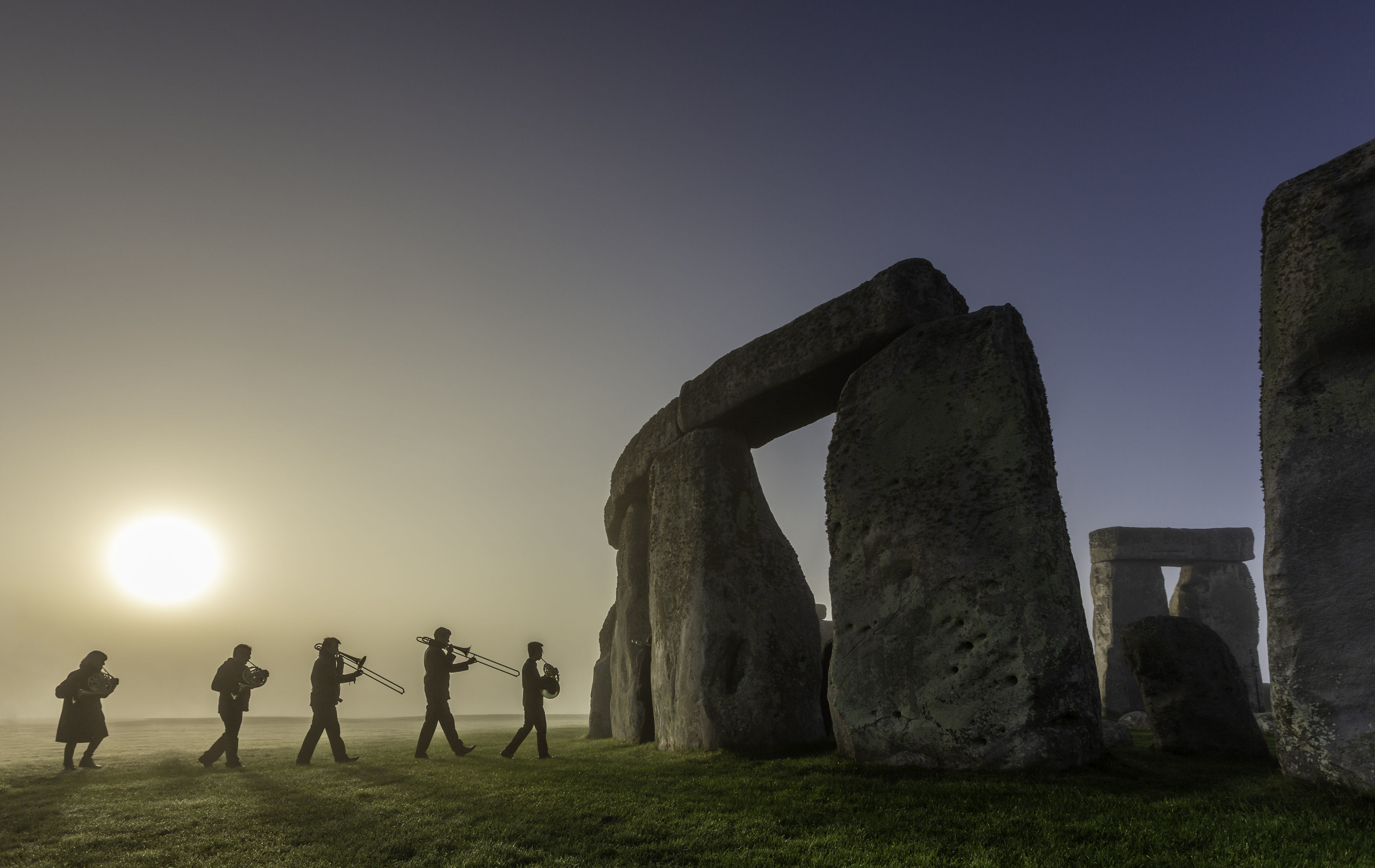 Musicians rehearsing at Stonehenge in Wiltshire ahead of English Heritage's celebrations marking 100 years since Stonehenge was donated to the nation