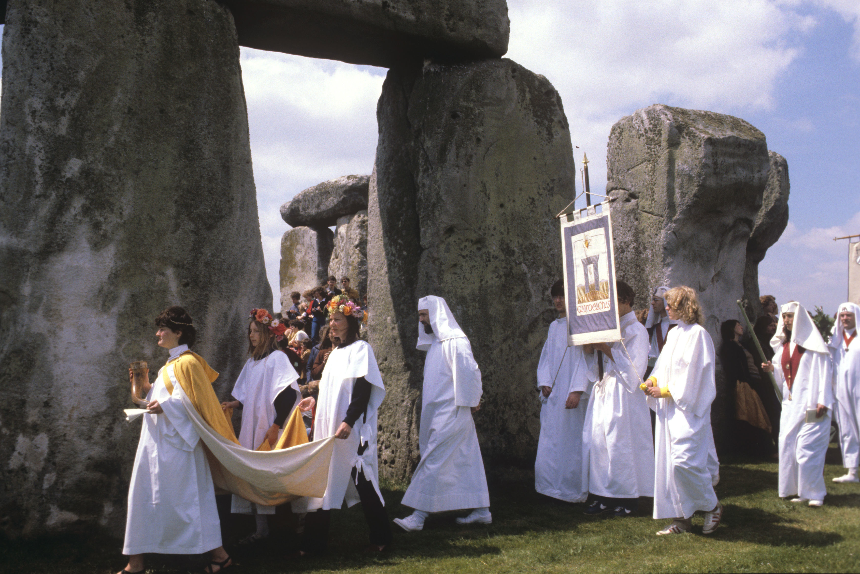 People wearing white robes during a procession in 1981 celebrating the Midsummer Solstice at Stonehenge