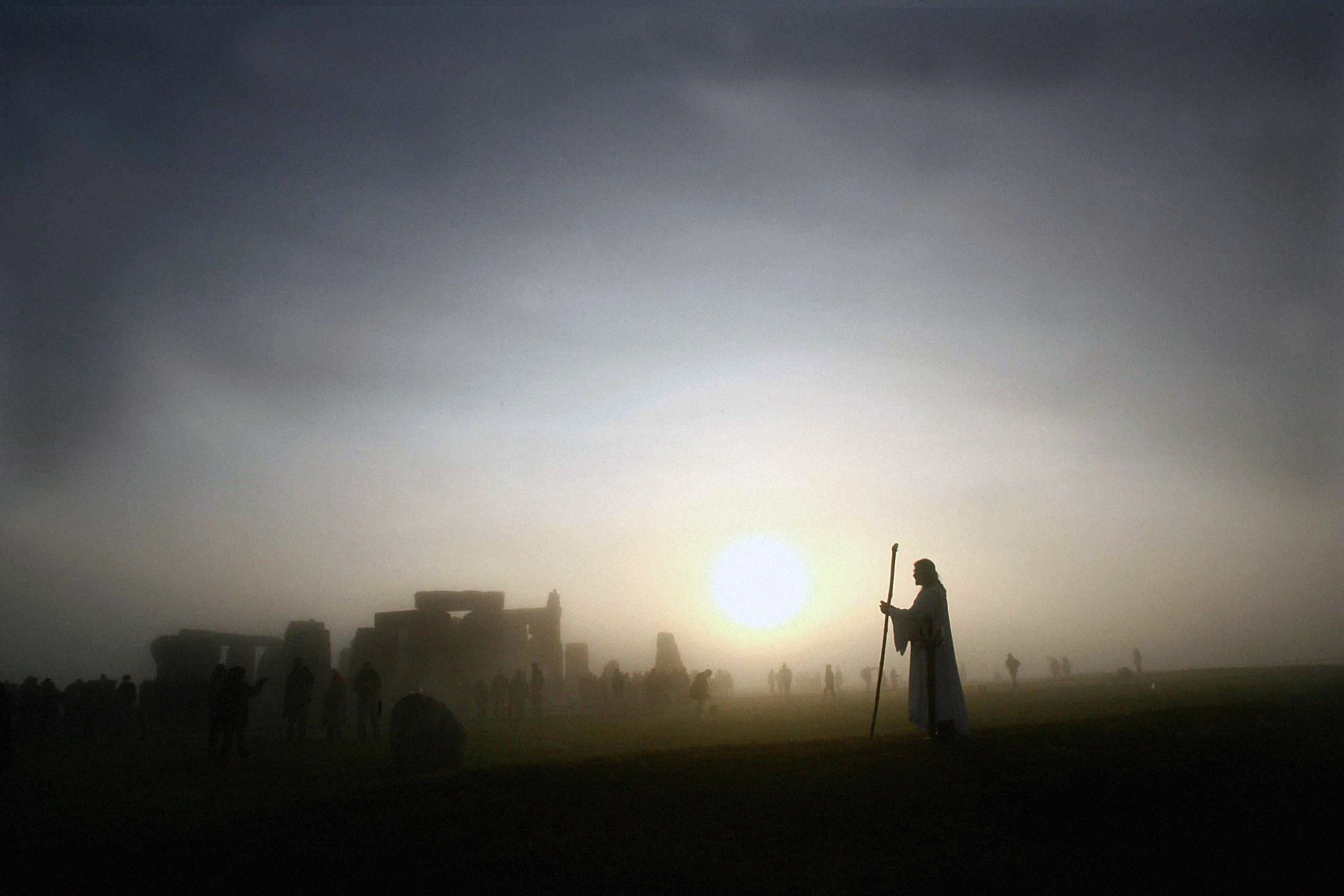 Arthur Pendragon watching the sunrise at Stonehenge in 2005