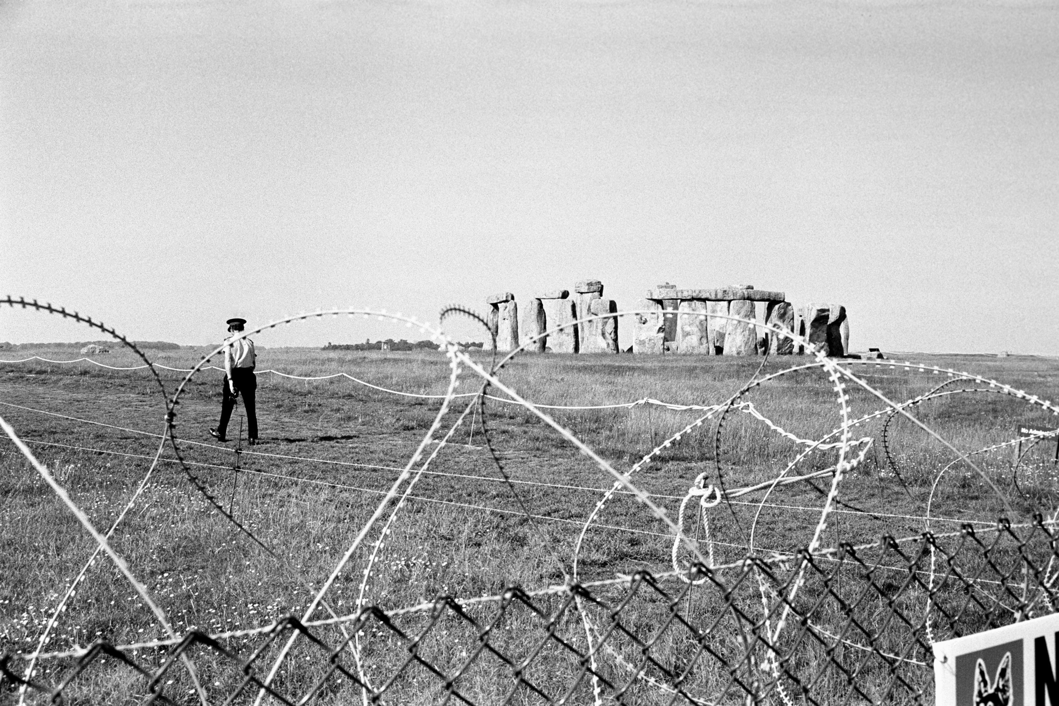 Barbed wire preventing people from reaching Stonehenge in 1985 after a pop festival was banned