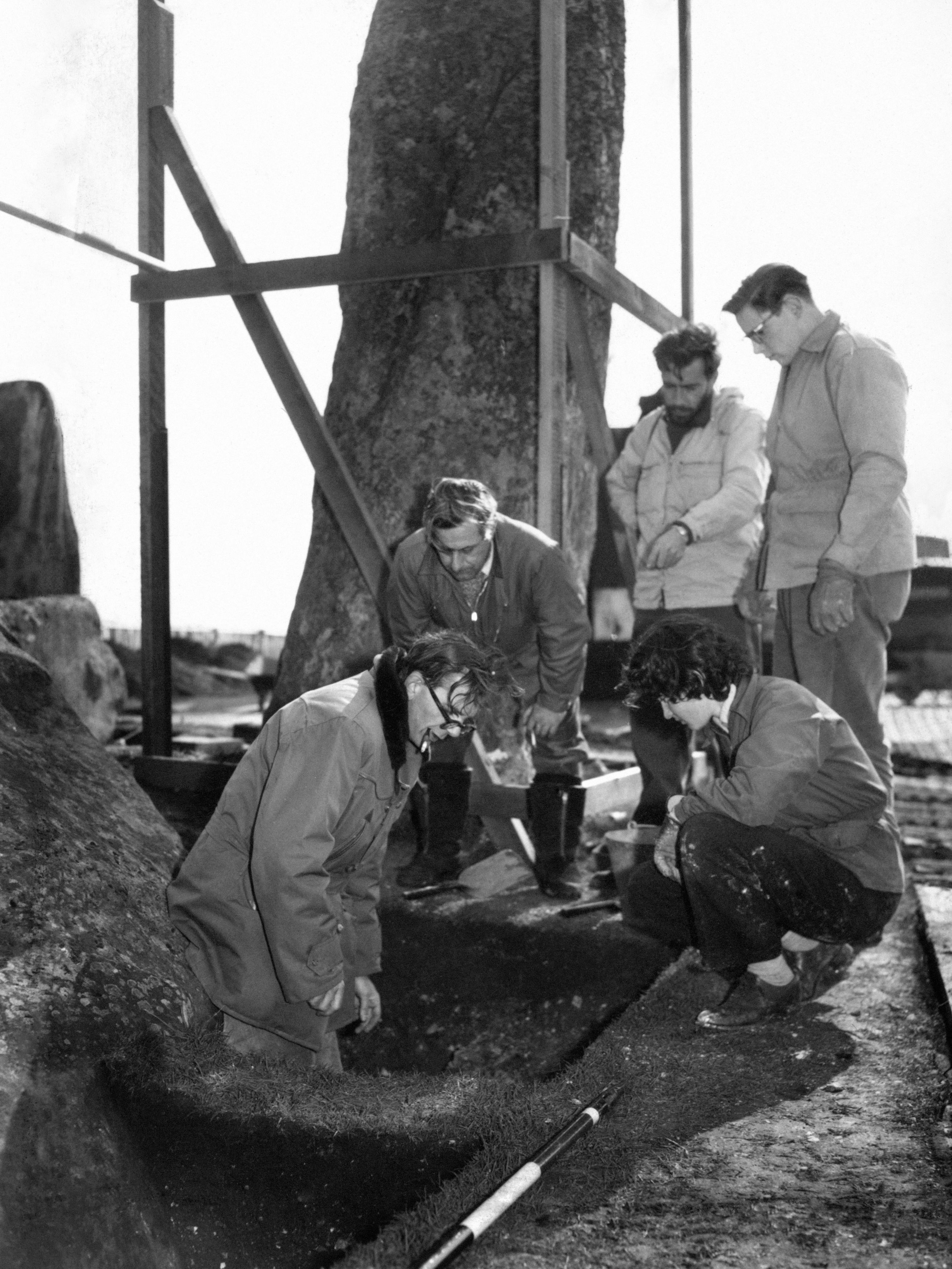 Edinburgh University Professor Richard Atkinson, left, looking for evidence of the origins of Stonehenge in 1958