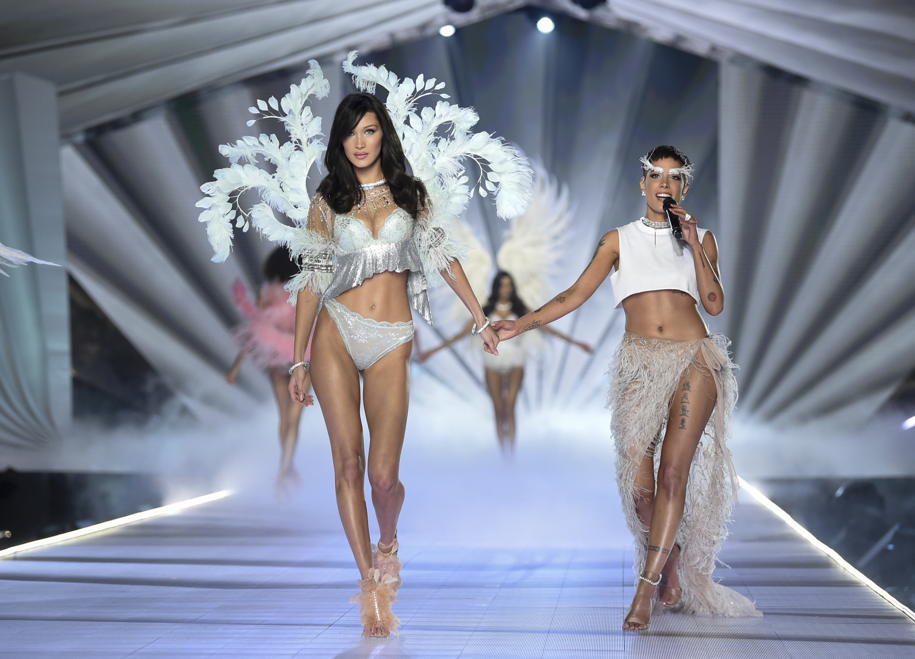 Model Bella Hadid, left, walks the runway as singer Halsey performs during the 2018 Victoria's Secret Fashion Show 2018