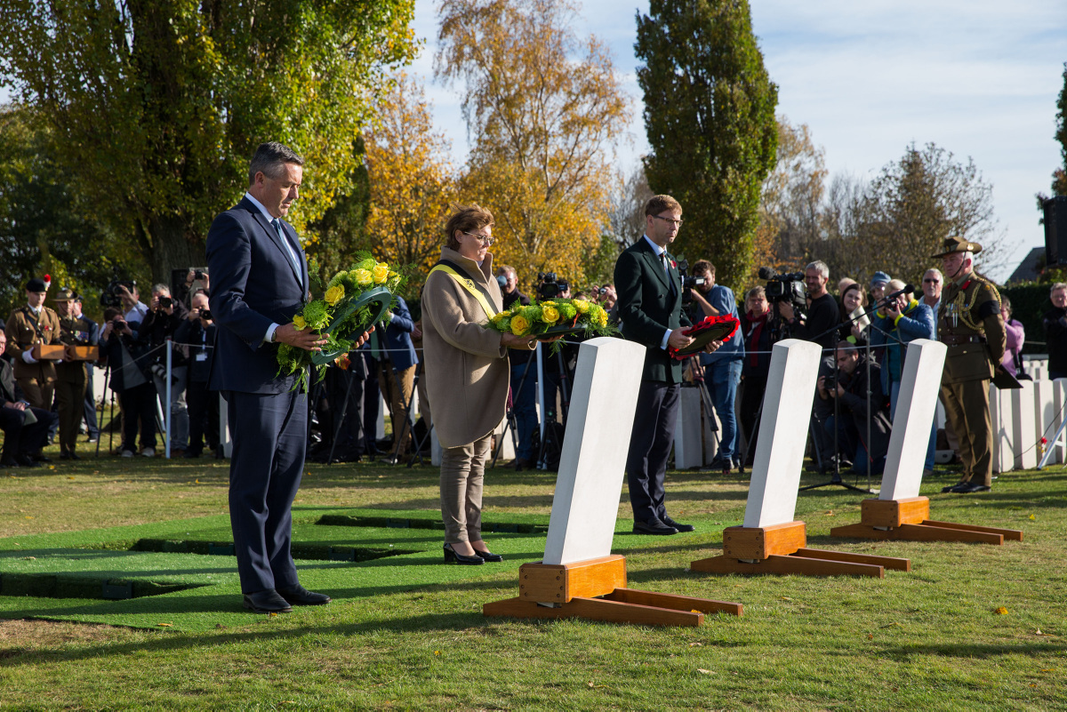 Australian Minister for Veterans' Affairs Darren Chester, MP (left), at a burial ceremony at Tyne Cot Cemetery, Belgium (Commonwealth of Australia/PA)