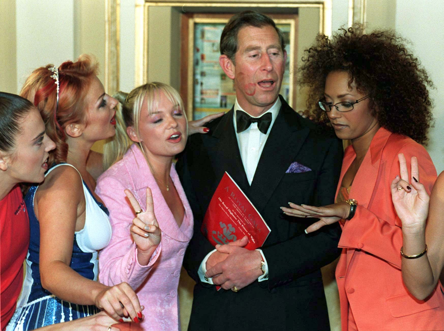 Prince of Wales joins the Spice Girls before the Royal Gala for The Princes Trust in 1997. (John Giles/PA).