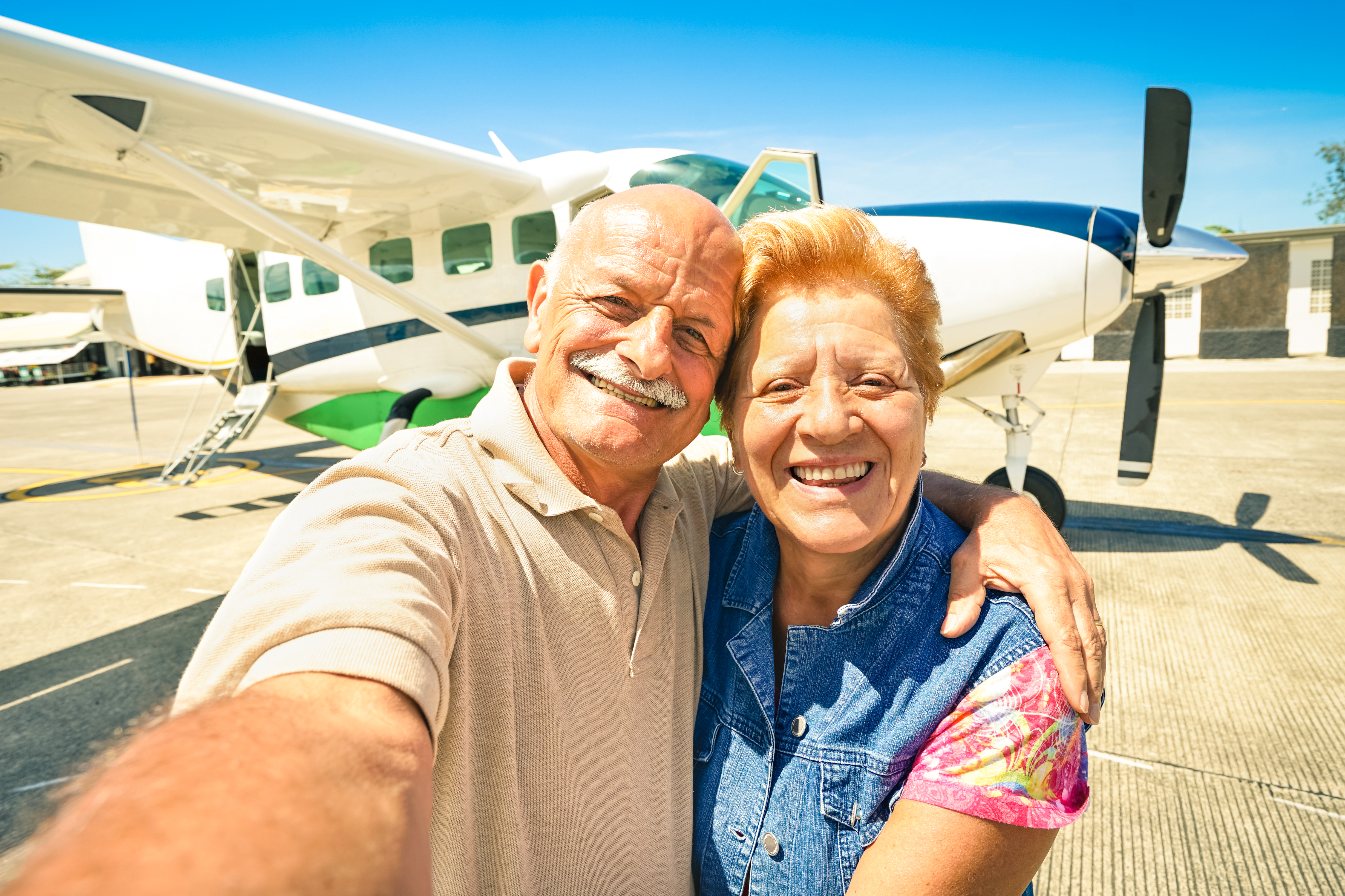 An elderly couple about to board a plane
