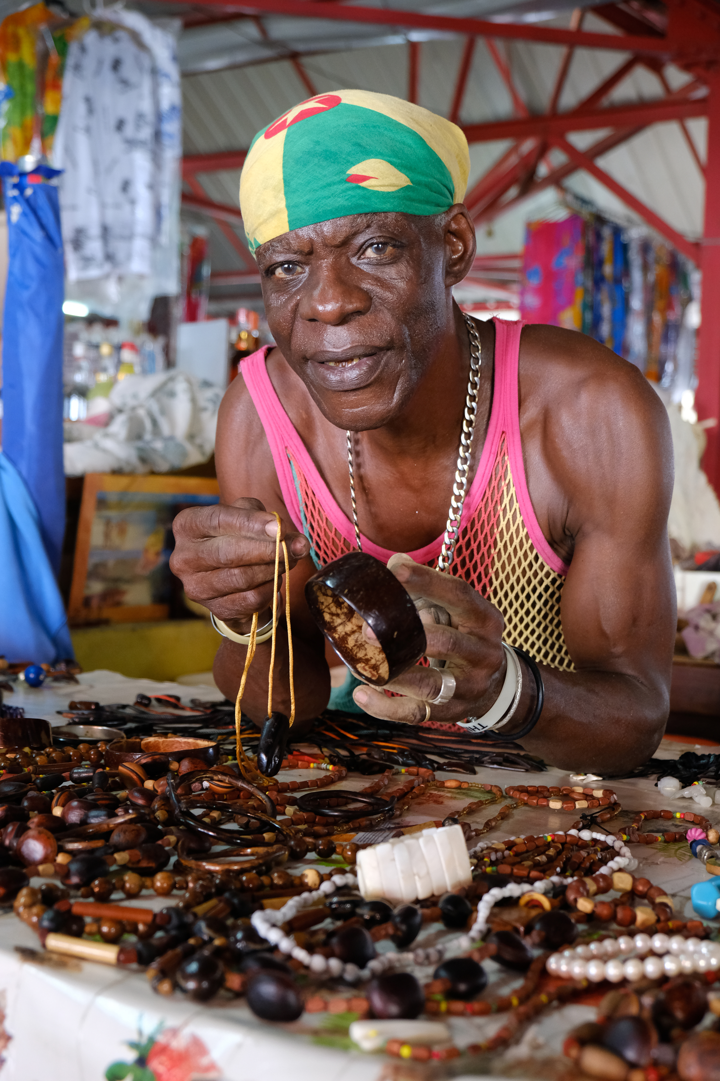 A local sells his own hand-made jewellery in the market (Stephen Patterson/PA)