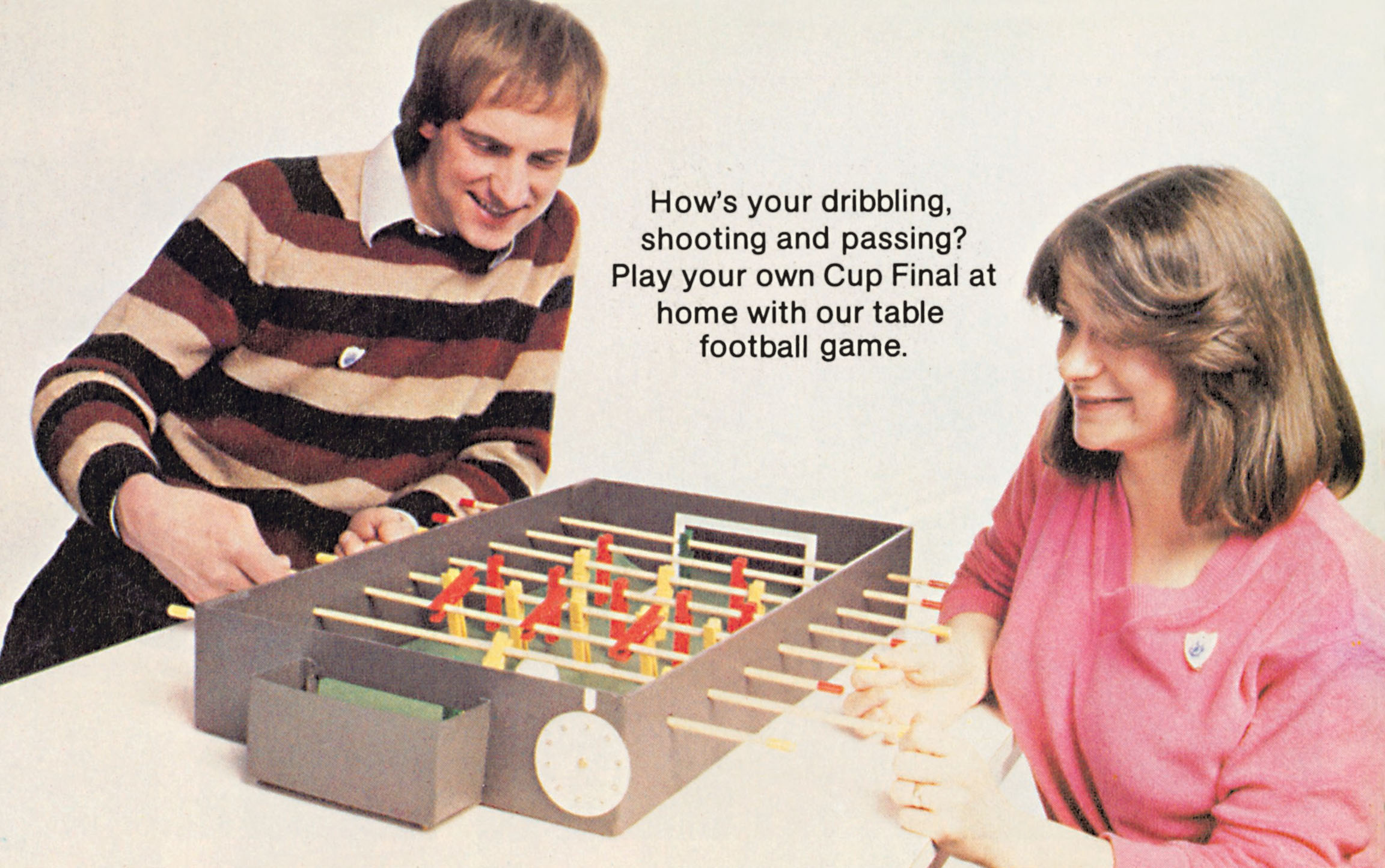 A man and a woman play table football together