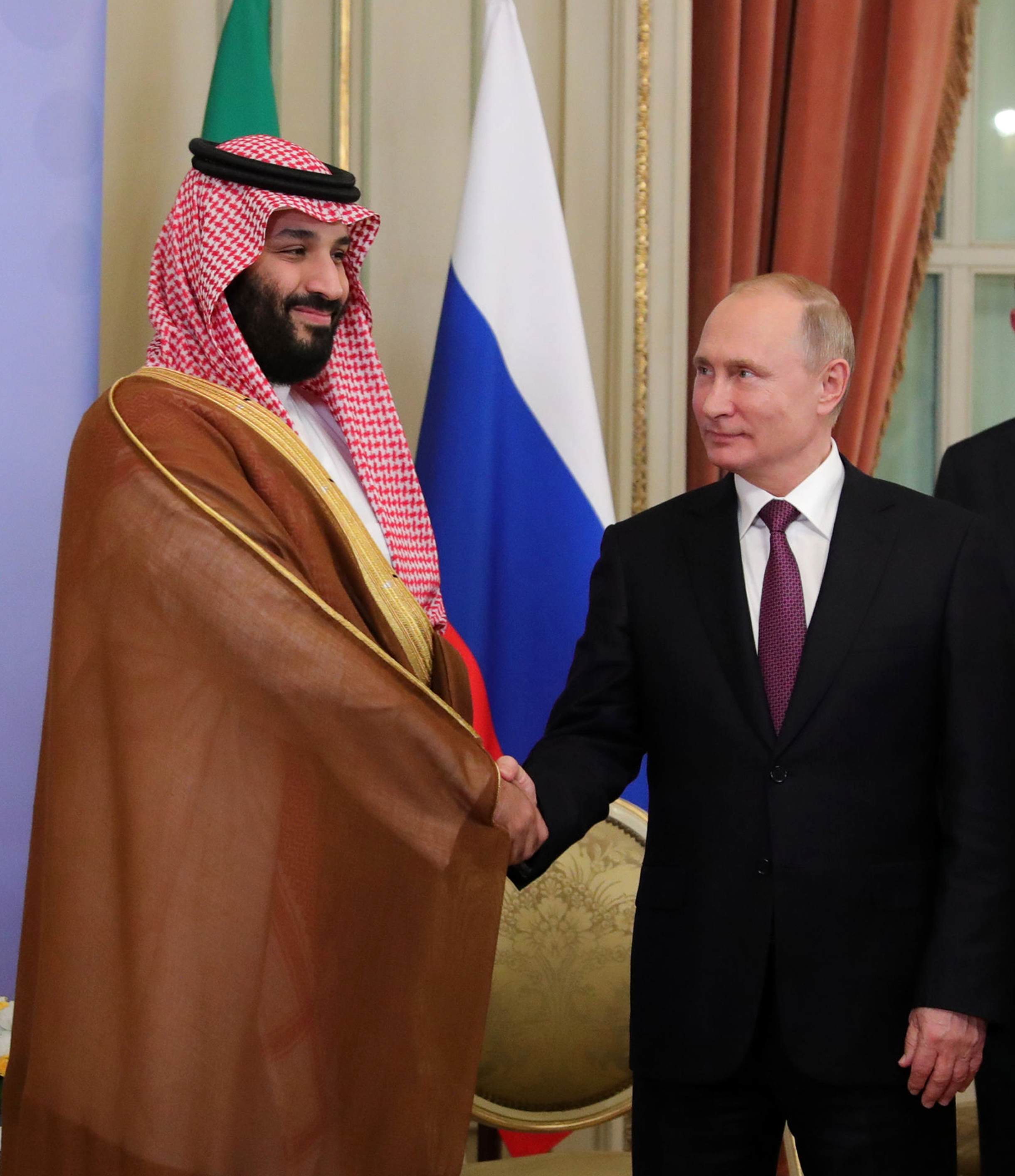 Saudi Arabia's Crown Prince Mohammed bin Salman, left, and Russian President Vladimir Putin, shake hands prior their talks at the G20 summit in Buenos Aires