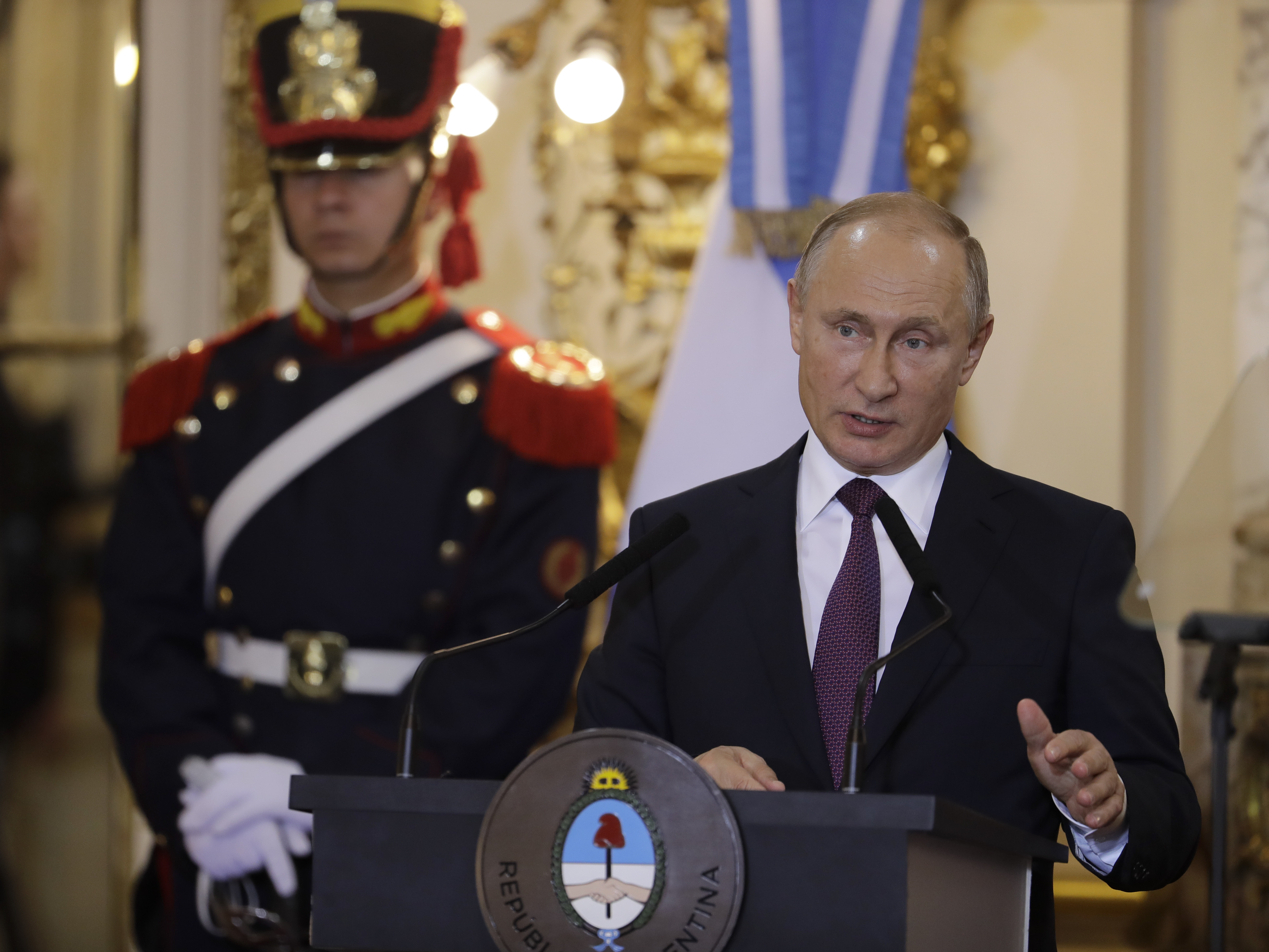 Russia's President Vladimir Putin speaks after meeting with Argentina's President Mauricio Macri at the presidential palace in Buenos Aires