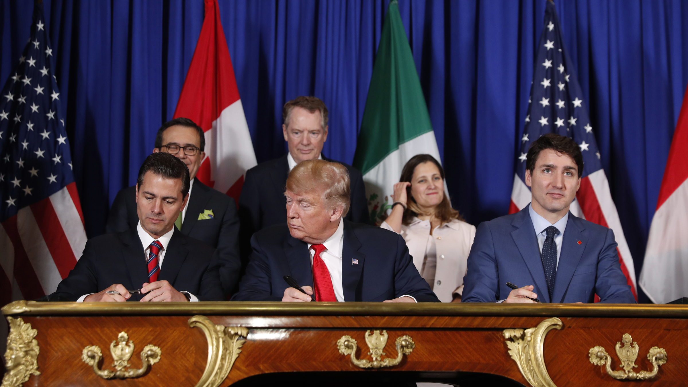 US President Donald Trump, Canada's Prime Minister Justin Trudeau, right, and Mexico's President Enrique Pena Nieto, left, participate in the USMCA signing ceremony in Buenos Aires
