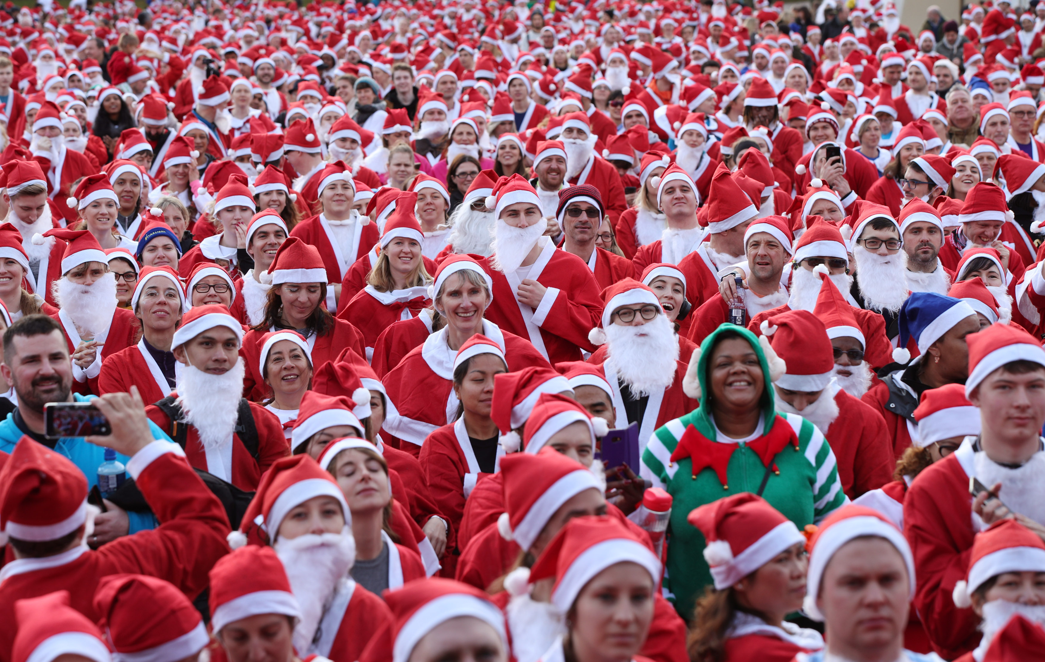 Participants taking part in the London Santa Run in Victoria Park, east London