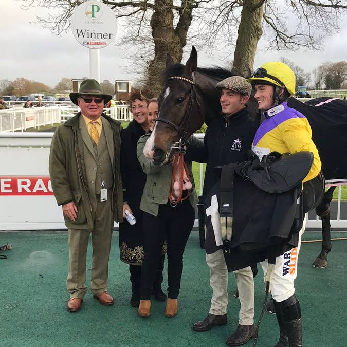Kalashnikov and connections after his victory in Plumpton's Sky Sports Racing Novices' Chase