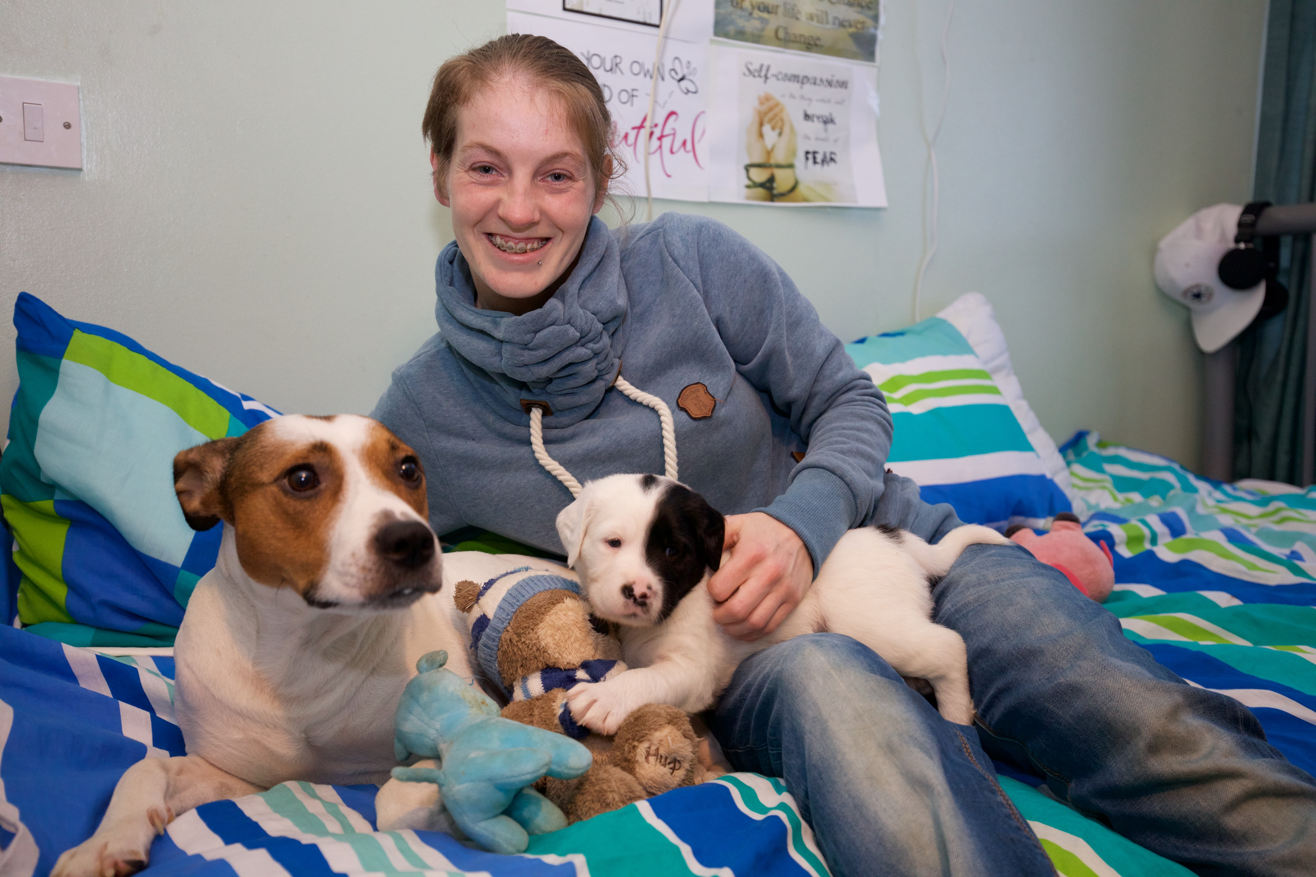 Natasha Robins with Harper the dog and one of her newborns