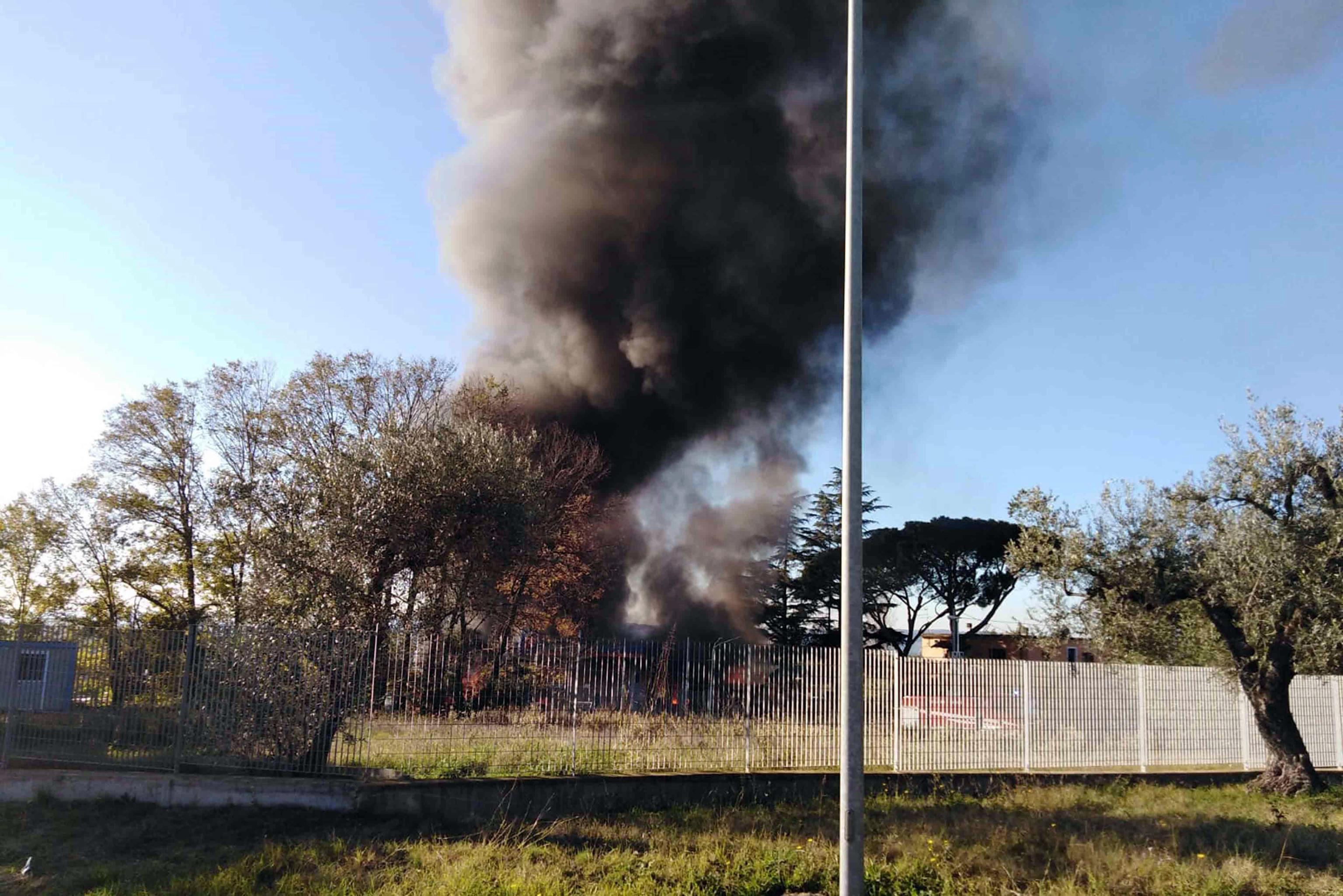 Smoke billows in the area where an explosion occurred at a petrol station in Borgo Quinzio, near Rieti, Italy